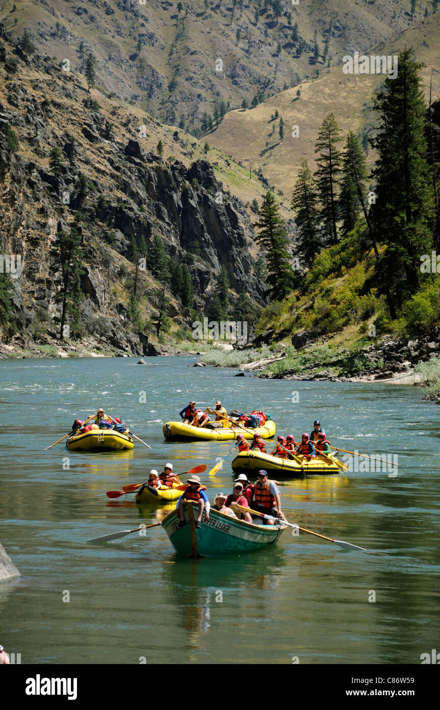 Rubber paddle boats, gear boat, dory and inflatable kayaks with the O.A.R.S. group on Main Salmon River in Idaho - Stock Image