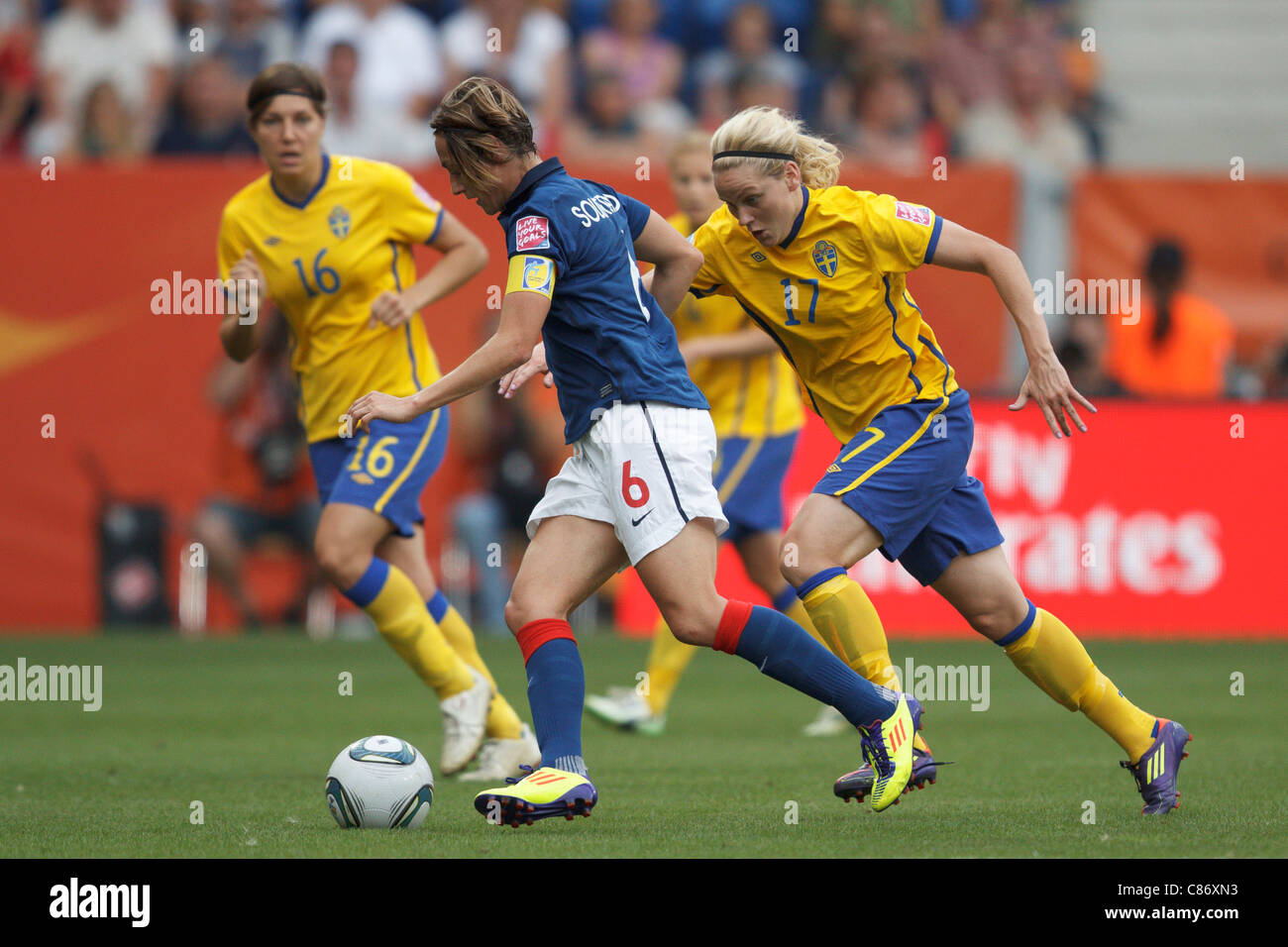 Sandrine Soubeyrand of France (L) controls the ball against Lisa Dahlkvsit of Sweden during the 2011 Women's - Stock Image