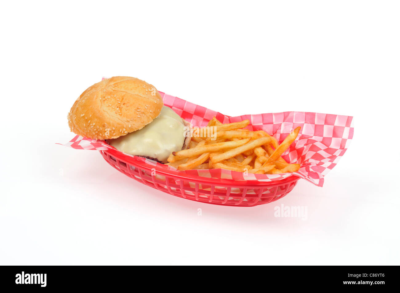 Cheeseburger with french fries in a red plastic  retro basket on white background, cut out. USA - Stock Image