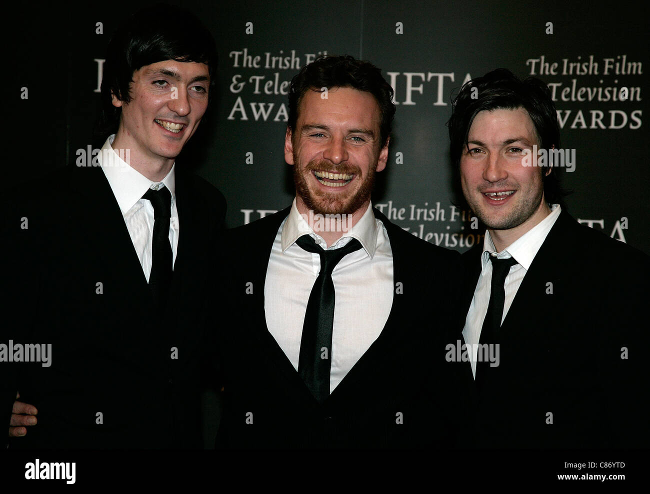 DUBLIN, IRELAND - FEBRUARY 14: Liam McMahon, Michael Fassbender and Brian Milligan arrive at the 6th Annual Irish Stock Photo
