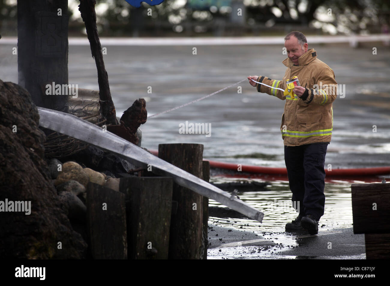 Fire personnel on the scene of a suspicious fire at Mapua's Touch the Sea aquarium, Nelson, New Zealand - Stock Image