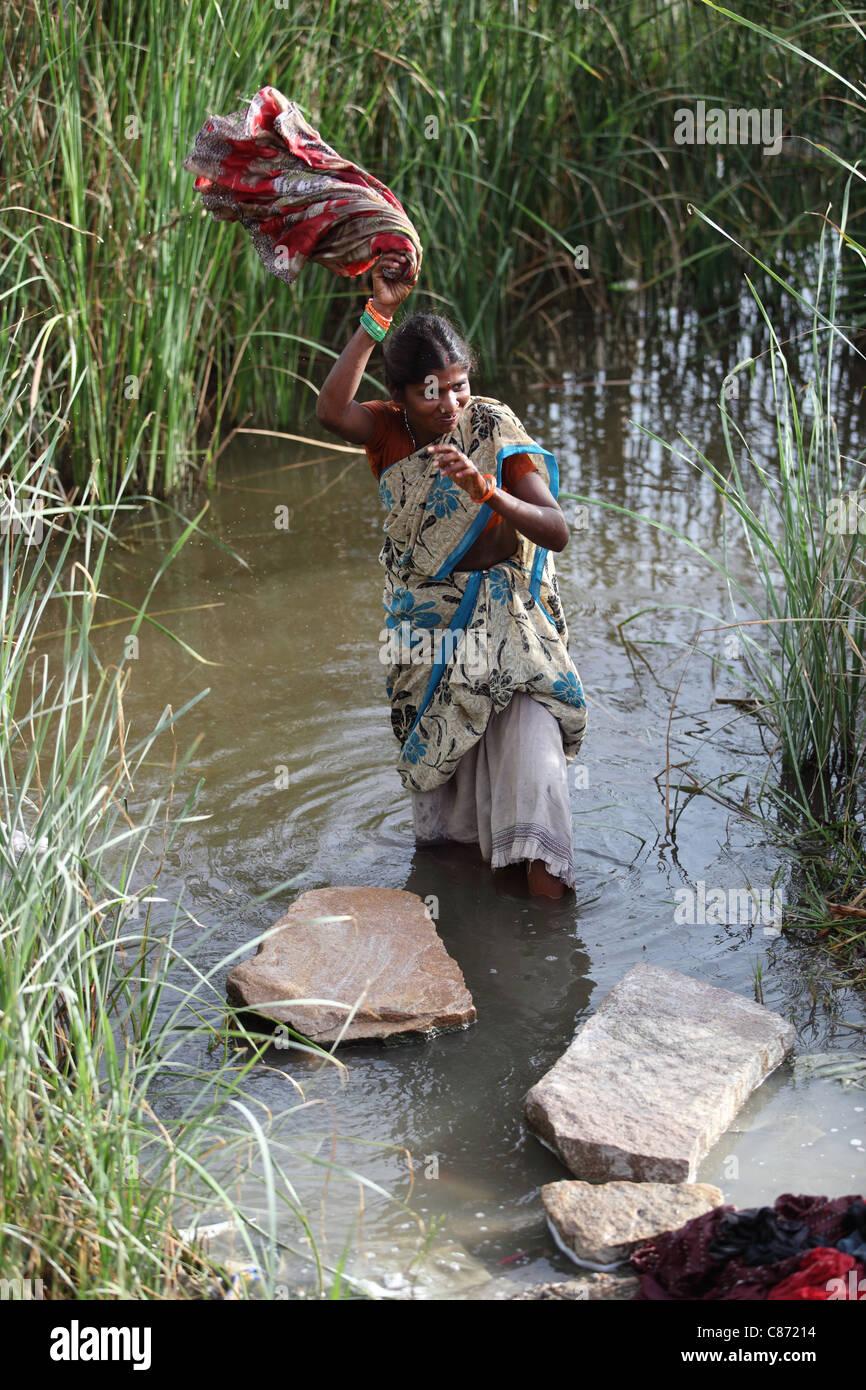 woman washing cloths Andhra Pradesh South India - Stock Image