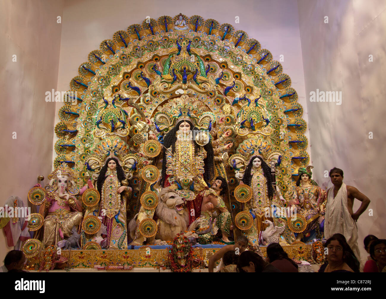 Intricately decorated depiction of Goddess Durga at 'Mudiali Club Puja pandal' in Kolkata (Calcutta), West - Stock Image