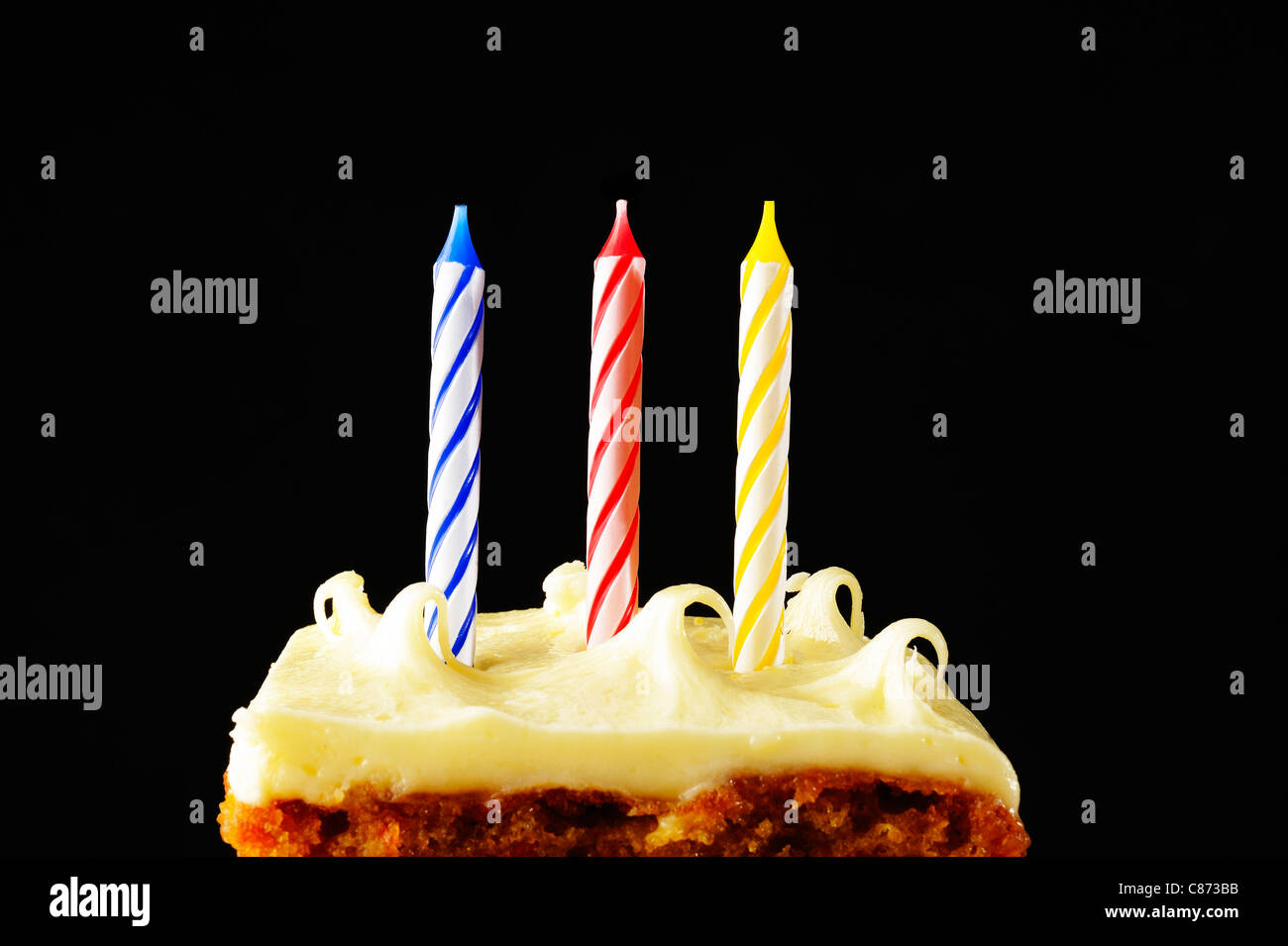 candles on a birthday cake - Stock Image