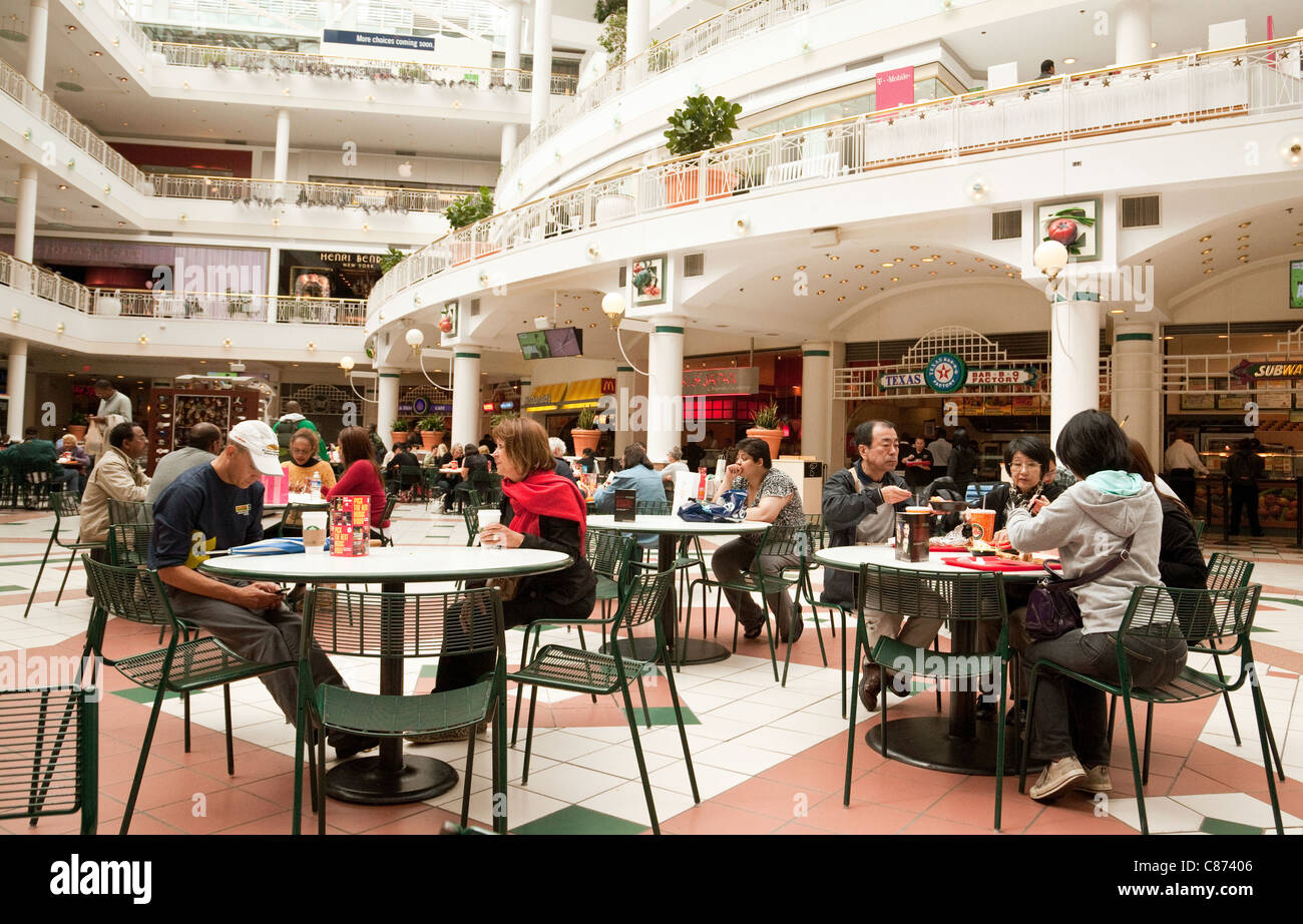 People eating at a cafe on the food court, Pentagon City shopping mall, Washington DC USA - Stock Image