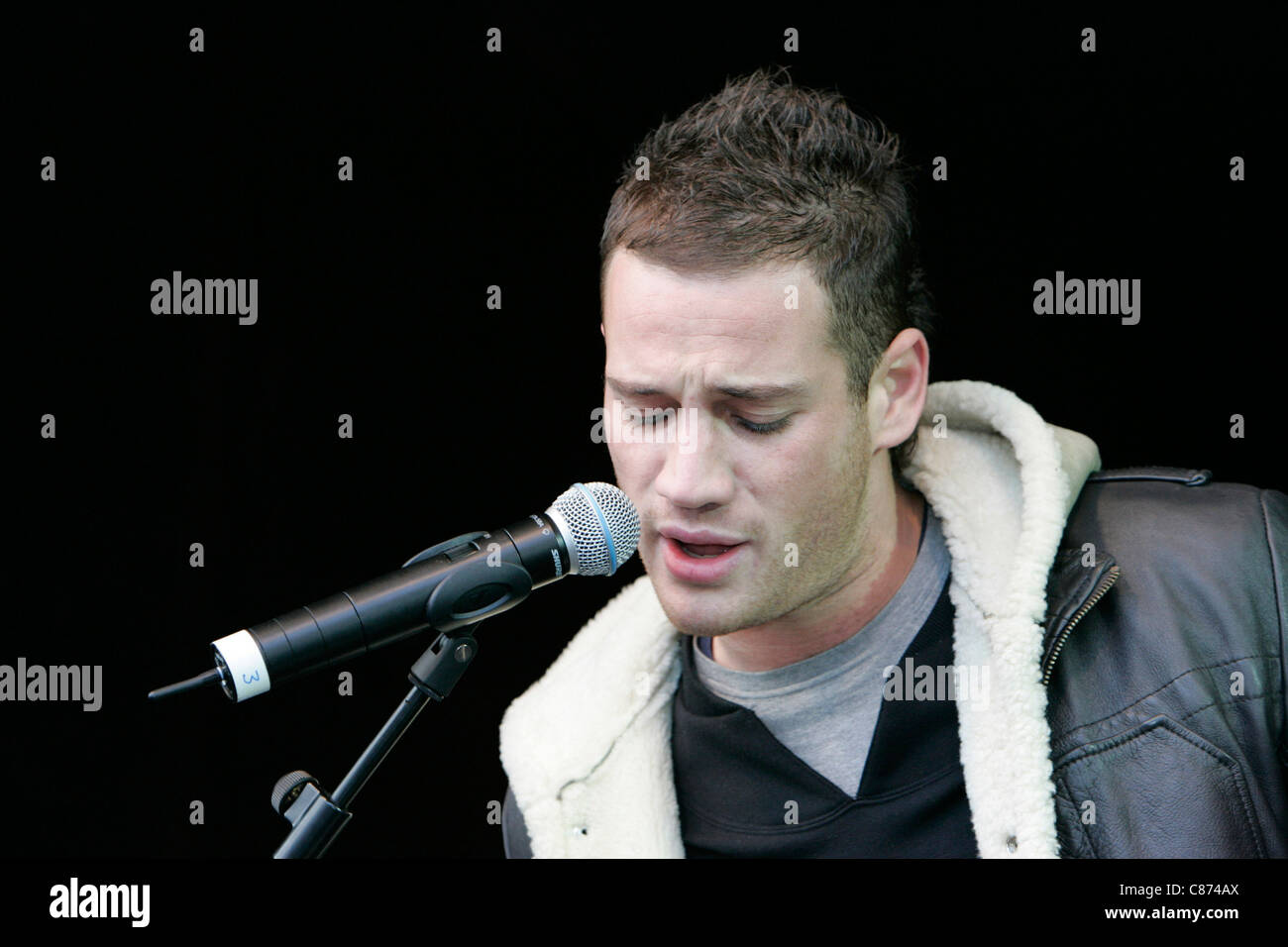 Kaz James of the Bodyrockers in Concert in Custom House Square for St Patricks Day Celebrations, Belfast City Centre. - Stock Image