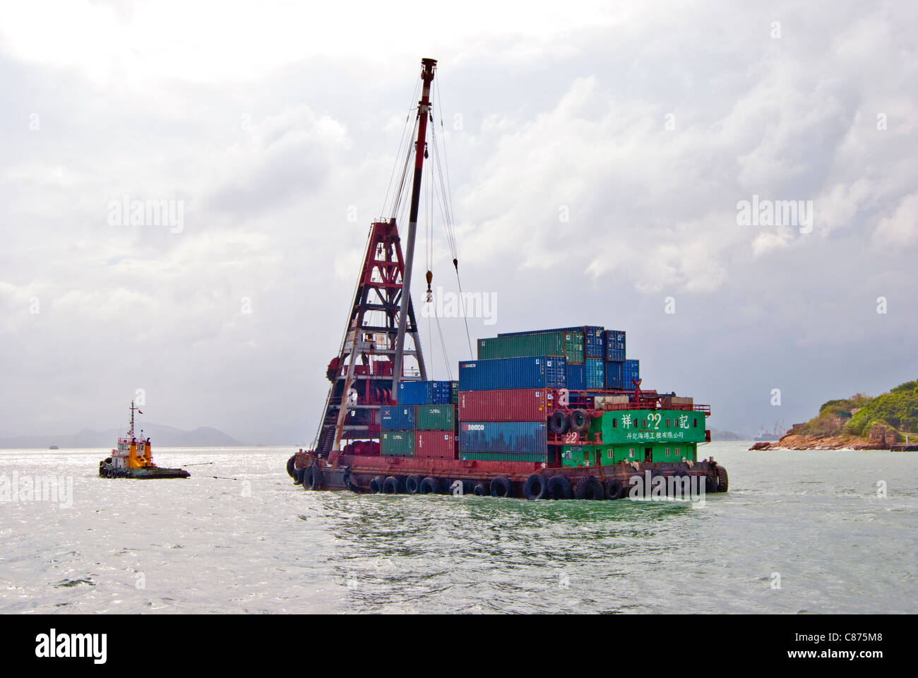 Container Transfer Barge with tug, Victoria Harbour, Hong Kong - Stock Image