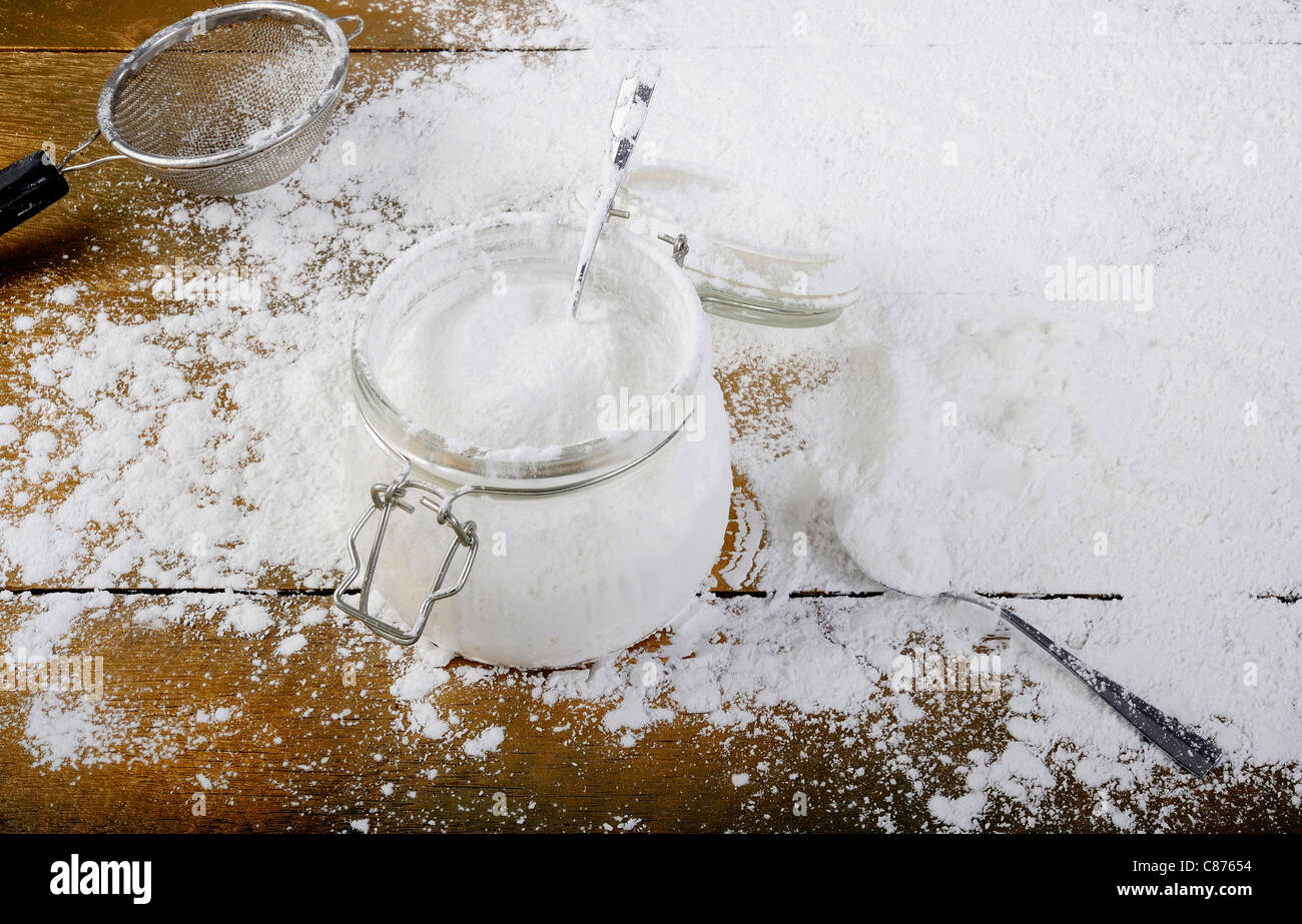 flour in the bottle on wood - Stock Image