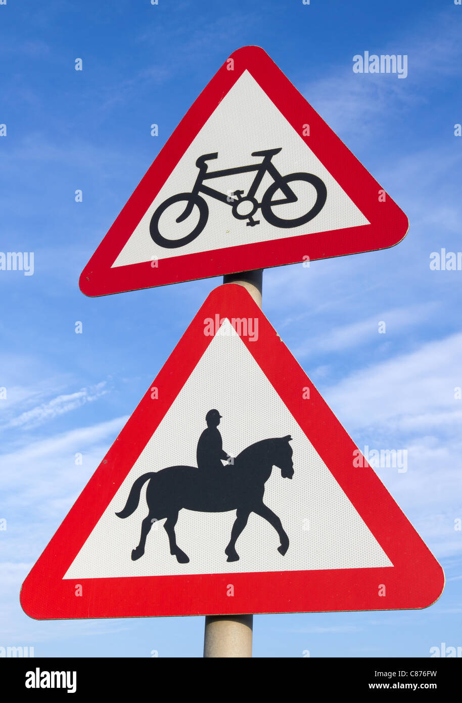 British cycle route ahead, accompanied horses or ponies, road signs. - Stock Image