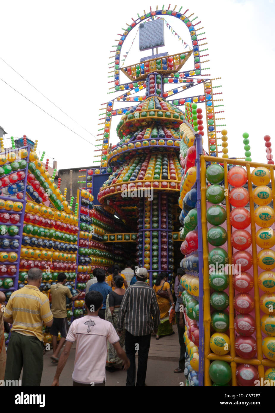 Durga puja decoration kolkata calcutta stock photos durga puja devotees at karbagan durga puja pandal made of coloured plastic balls in ultadanga altavistaventures Choice Image