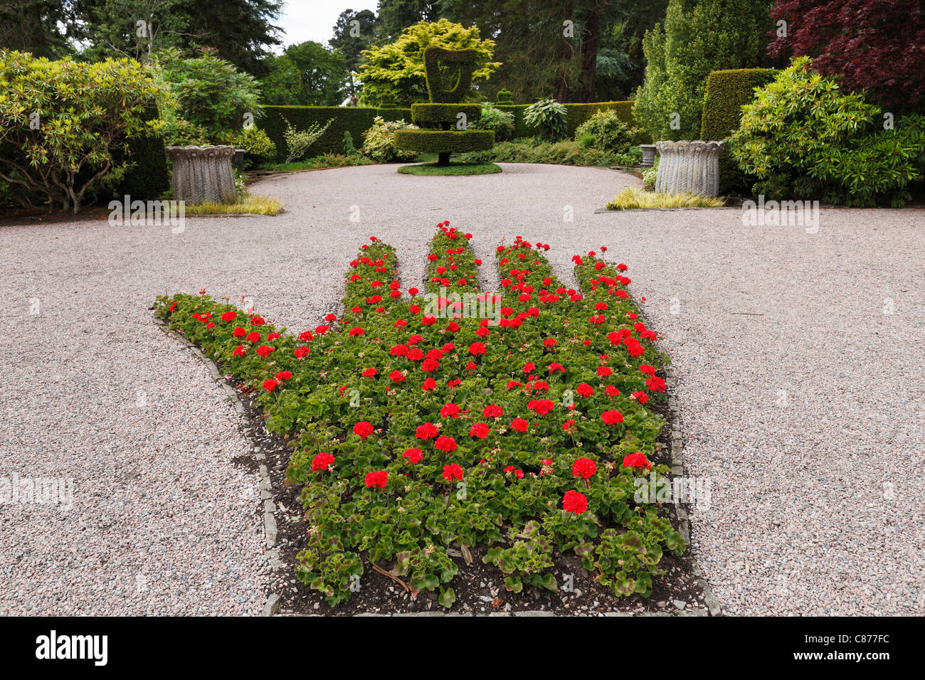 Northern Ireland, County Down, Newtownards, View of red Ulster hand made up of flowerbed at Mount Stewart gardens - Stock Image