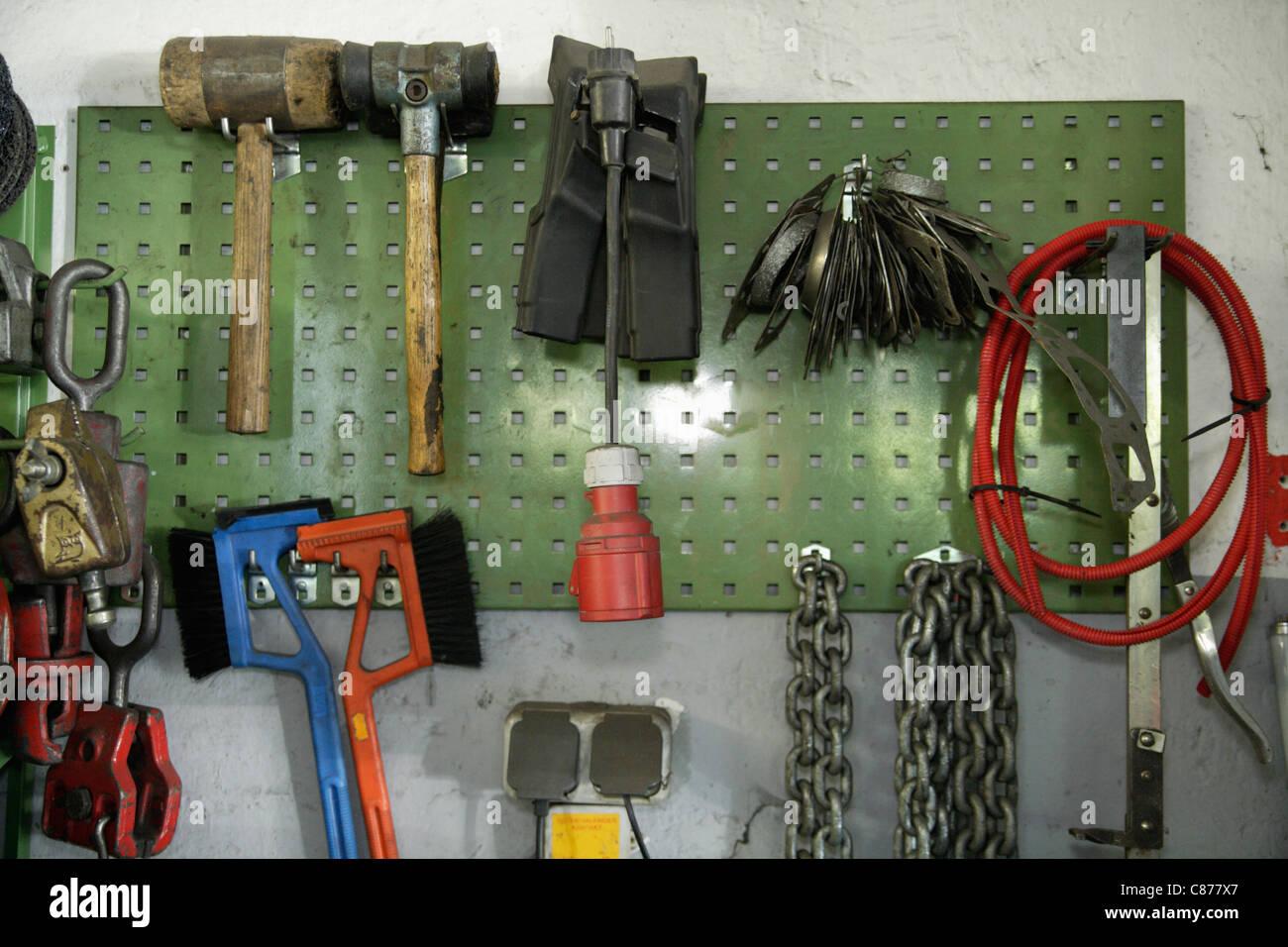 Germany, Ebenhausen, Work tools on pegboard in repair garage - Stock Image