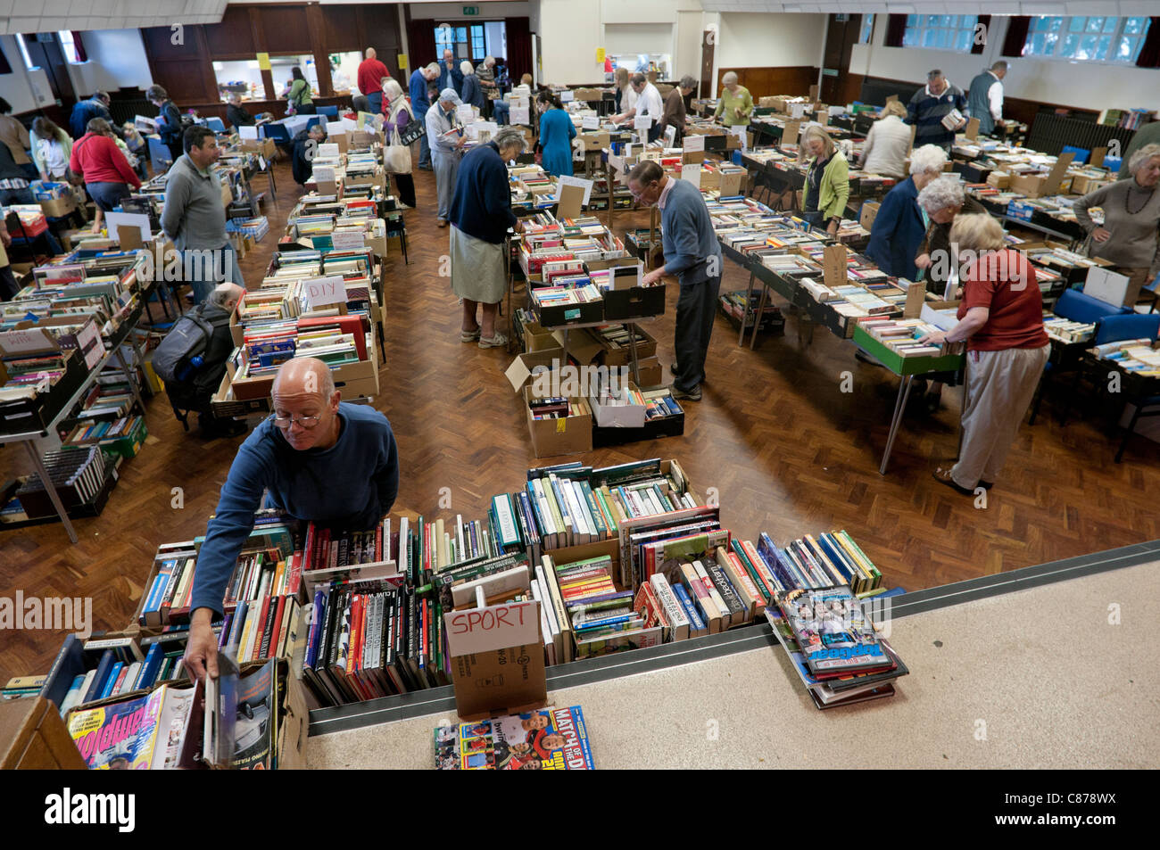 Charity book fair in a village hall in Surrey, UK - Stock Image