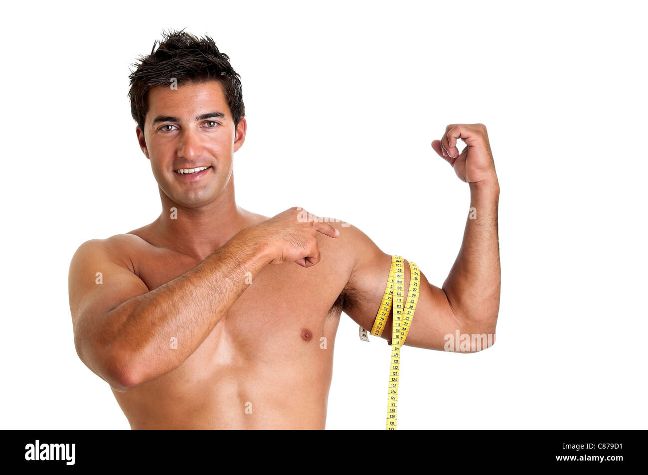 Muscular young man with measuring tape - Stock Image