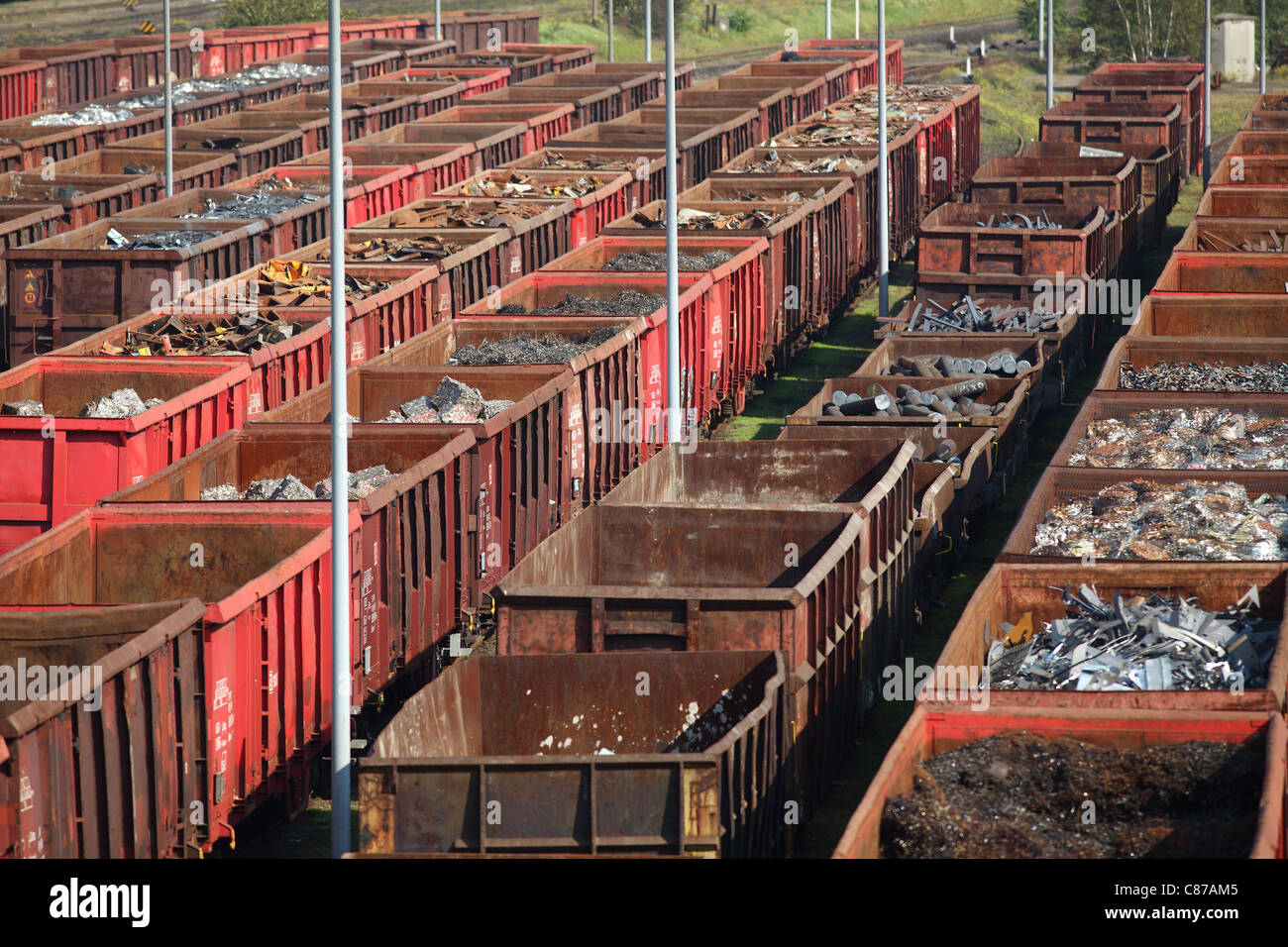 Freight depot, freight yard. Scrap metal in railway wagons, for melt down in a steelworks, recycling of old metal. Stock Photo