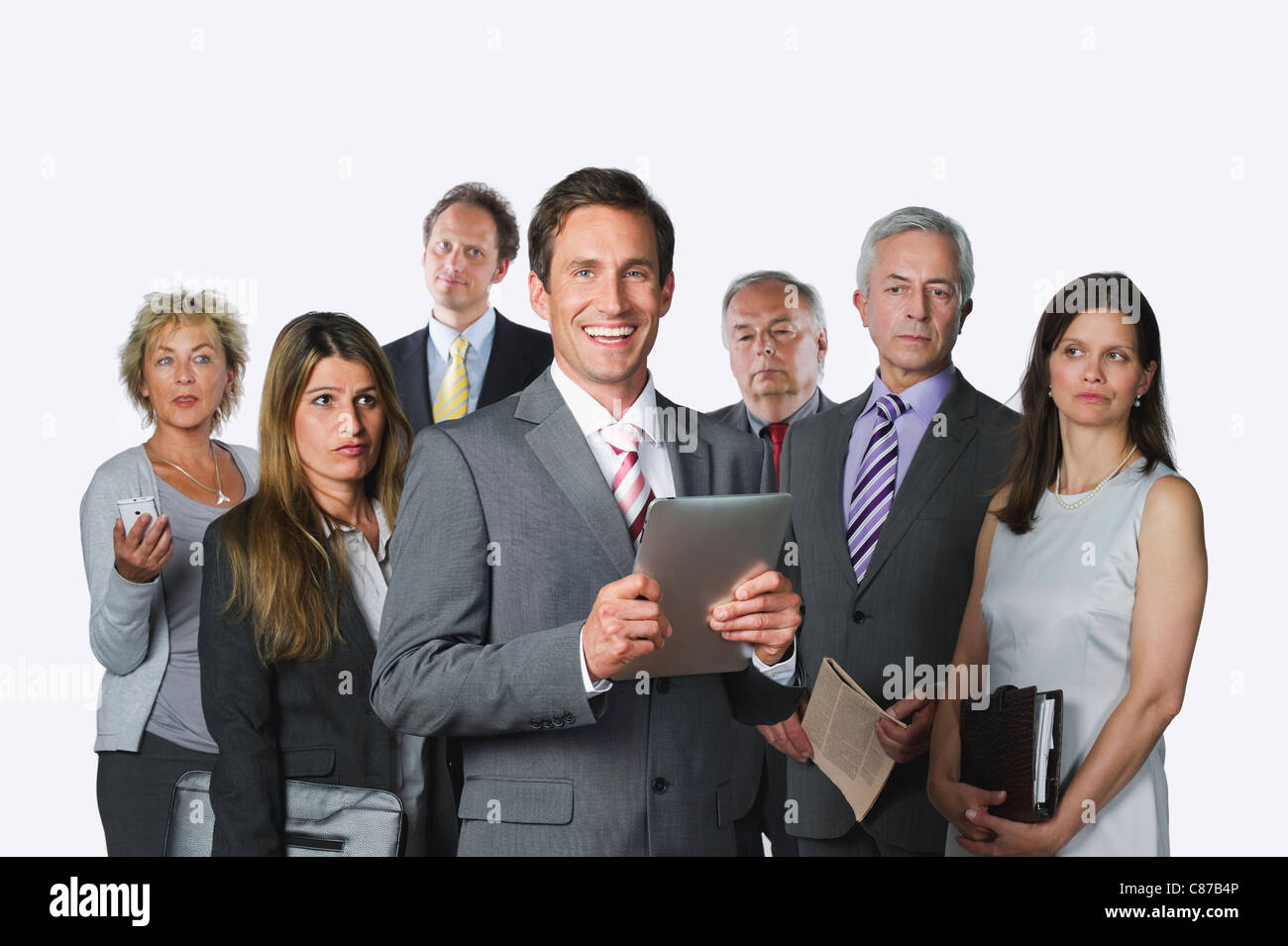 Business people with digital tablet, file, diary, mobile phone and newspaper against white background Stock Photo