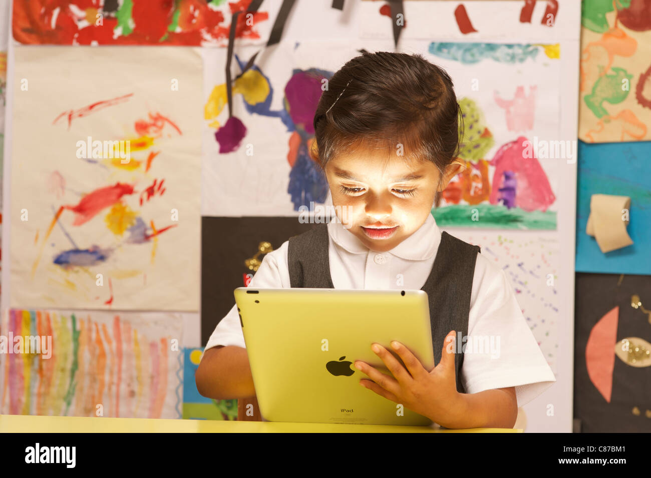 A young girl with ipad 2 - Stock Image