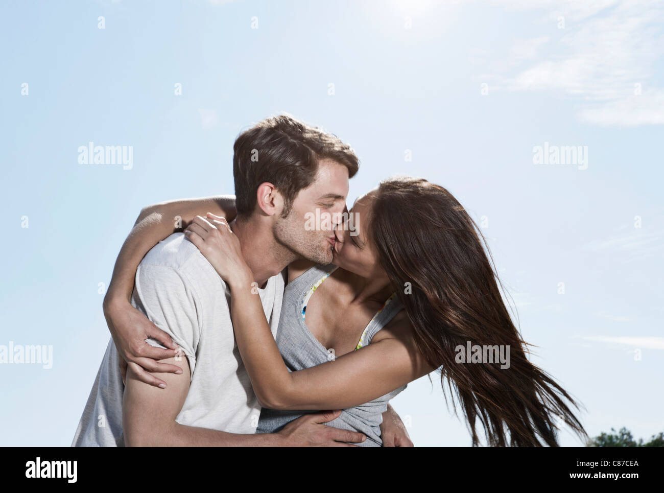 Spain, Majorca, Young couple kissing each other - Stock Image