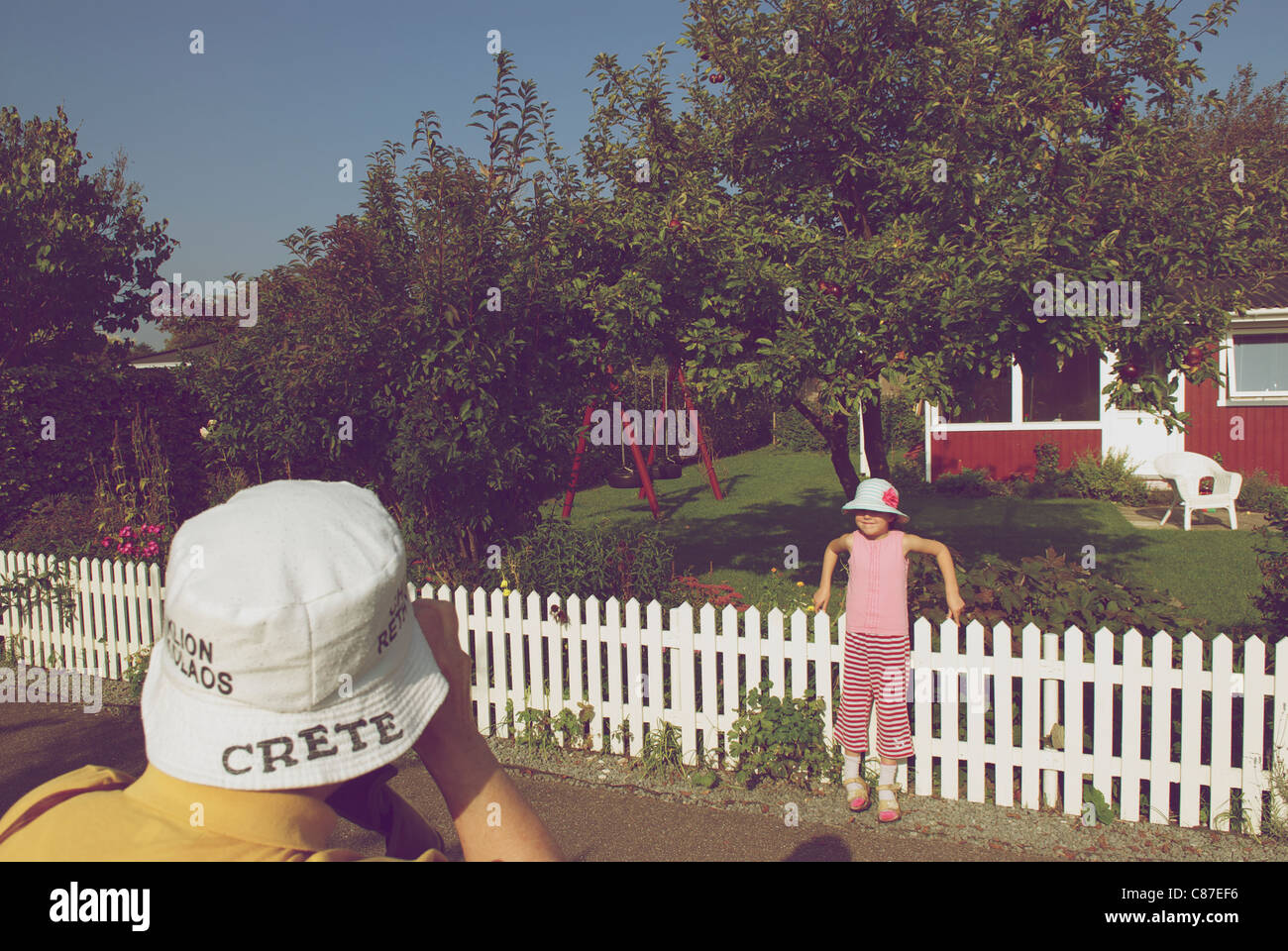 PHOTOGRAPHING HER GRANDDAUGHTER - Stock Image