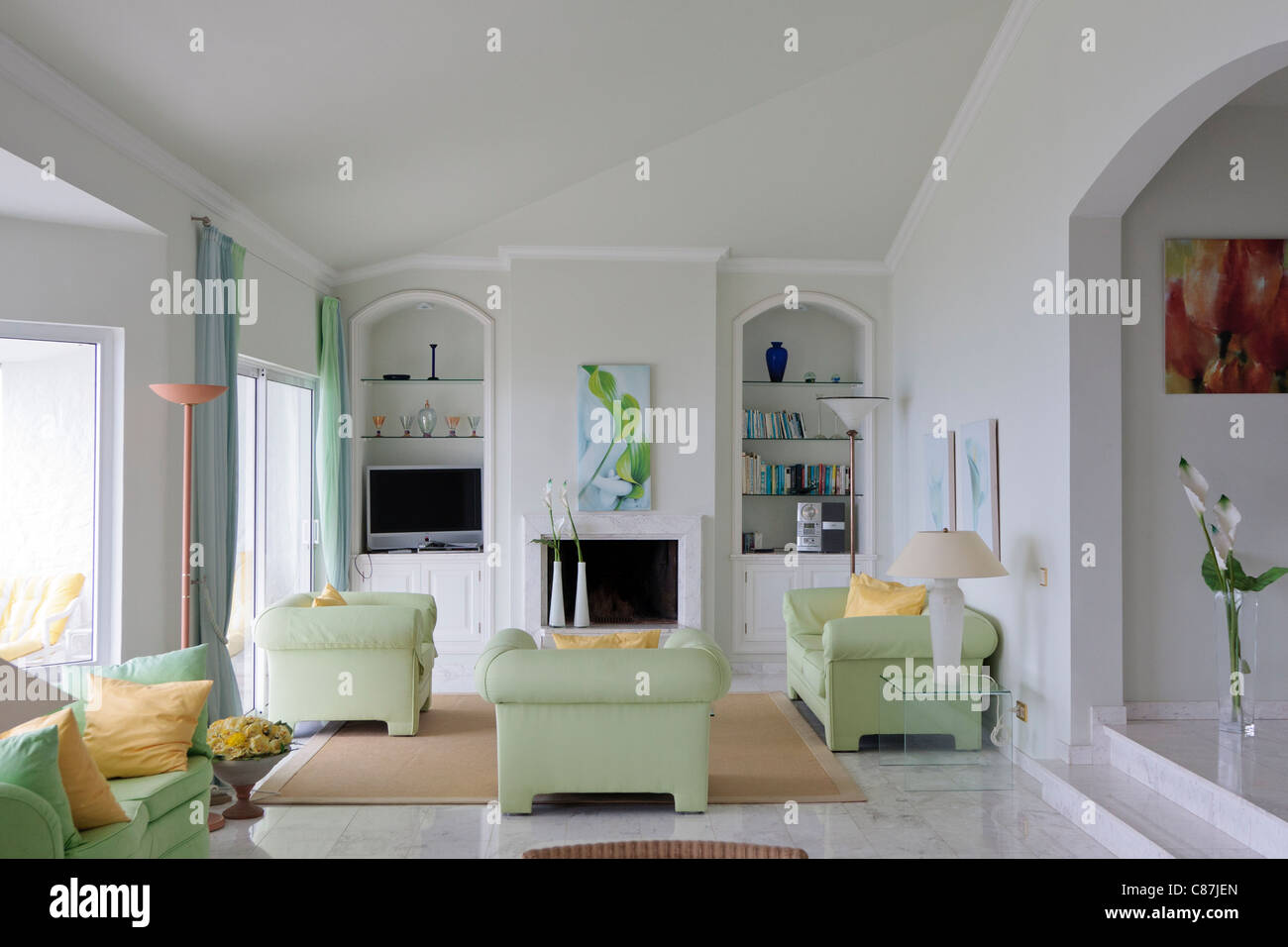 Modern Lounge Room With Light Green Sofas, Chairs, Tv, Stereo, With Marble  Floor