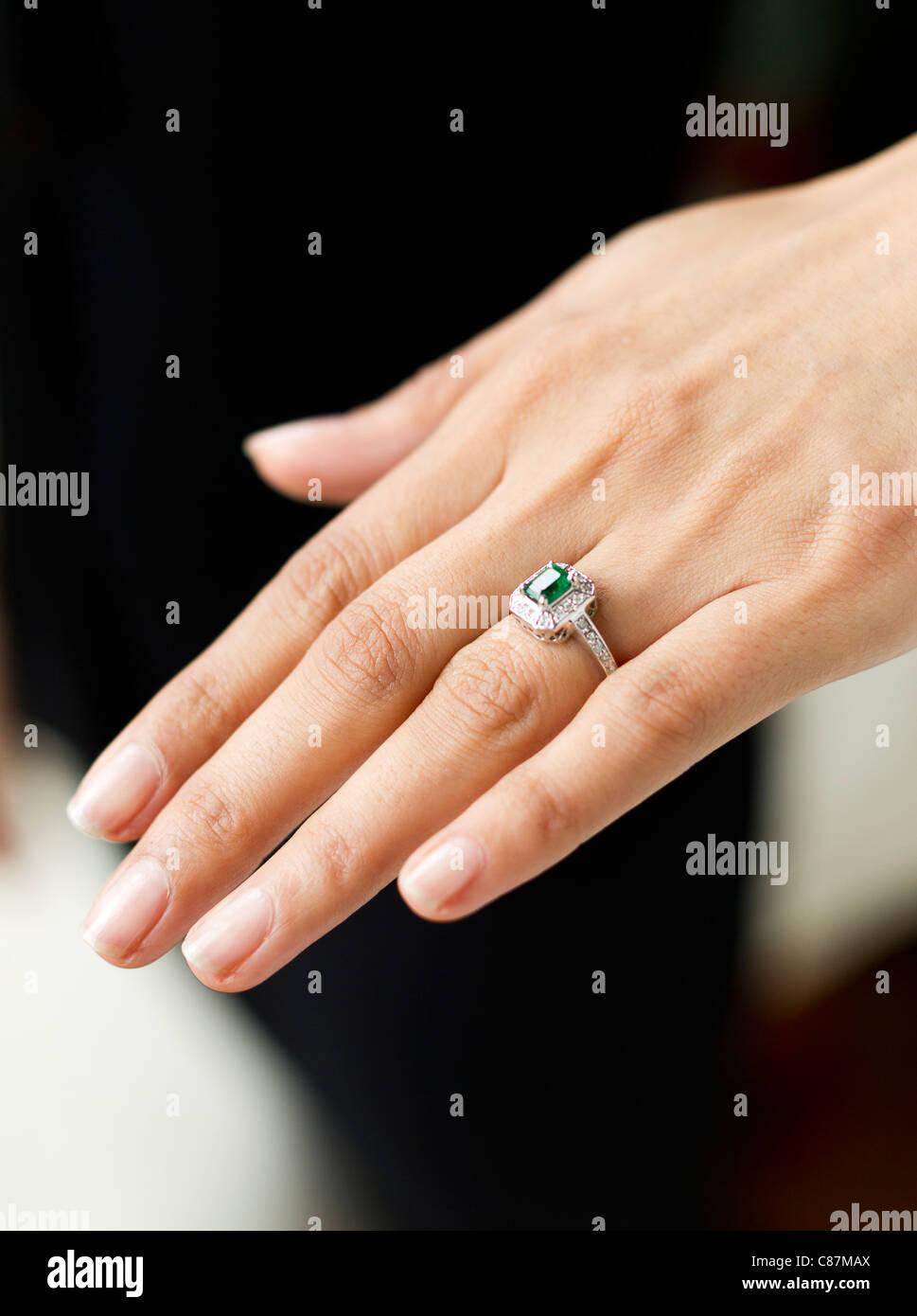 Woman wearing engagement ring - Stock Image