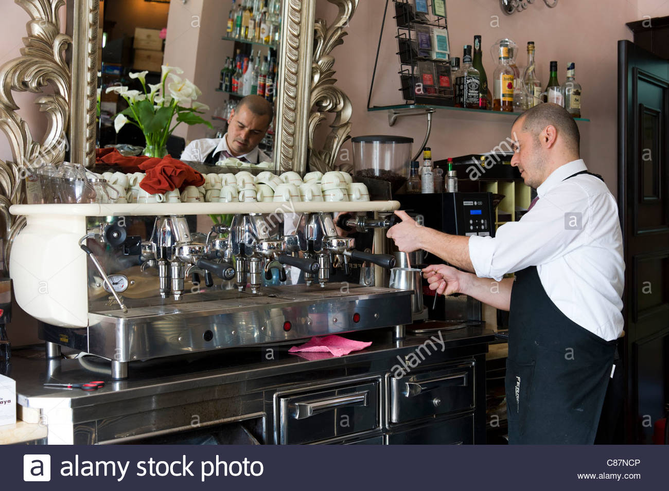 Barista Using Espresso Coffee Machine In Cafe Sassari