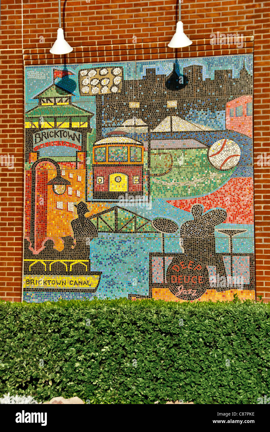 'History of Bricktown' mosaic murals by Susan Morrison, on facade of the AT&T Bricktown Ballpark, Oklahoma - Stock Image