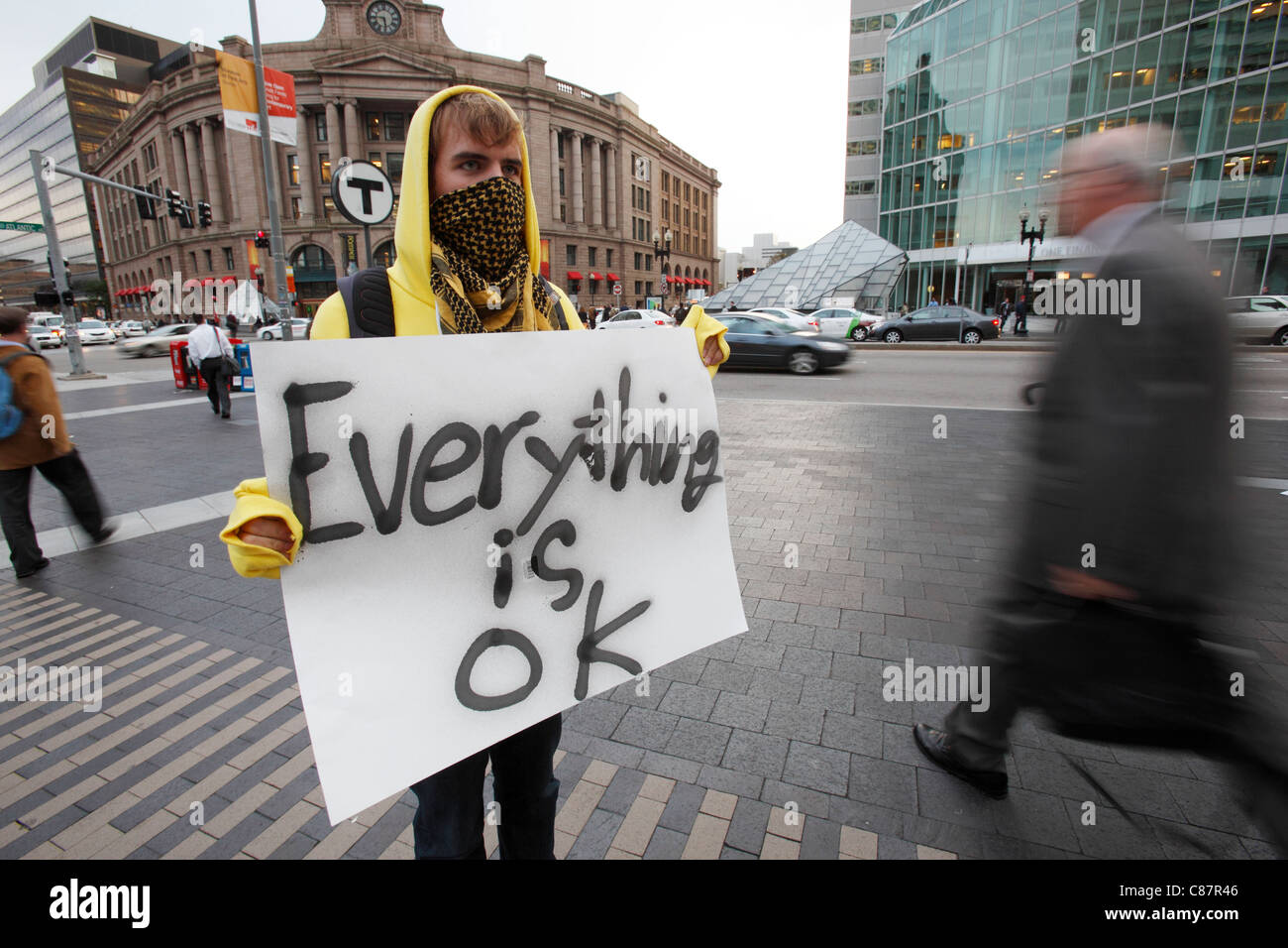 An Occupy Boston demonstrator protests in front of South Station in downtown Boston, Massachusetts - Stock Image