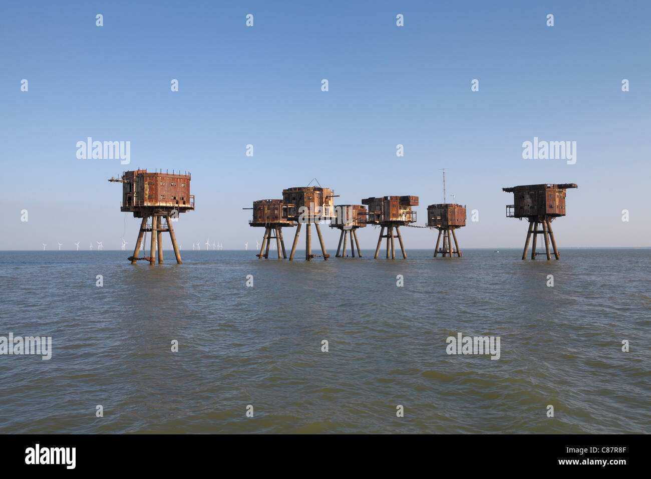 Maunsell sea forts. Red Sands sea fort Thames estuary, now abandoned. The Kentish flats windfarm is just behind - Stock Image