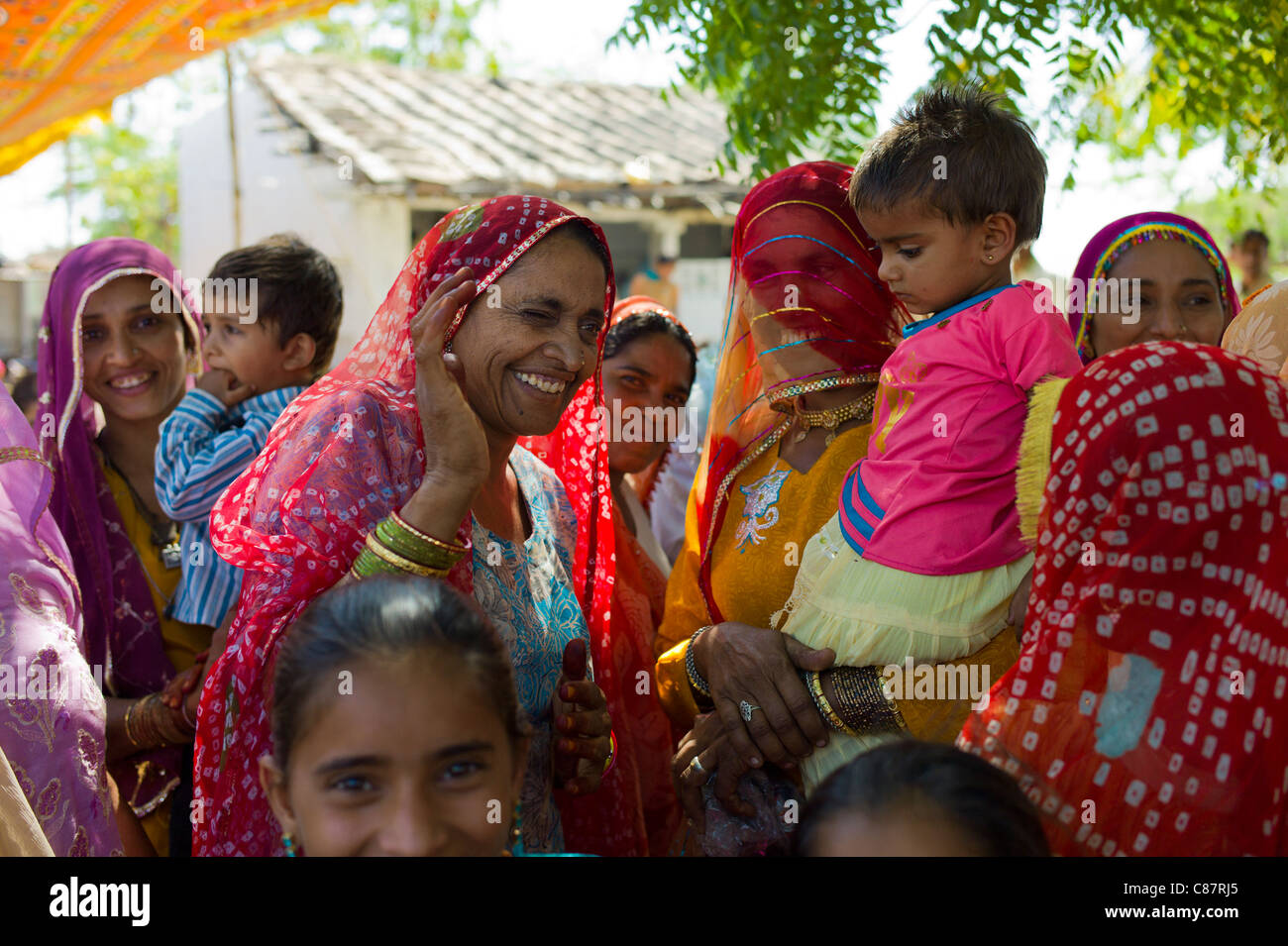 Indian wedding with guests dressed in their finest embellished saris in village of Rohet in Rajasthan, Northern - Stock Image