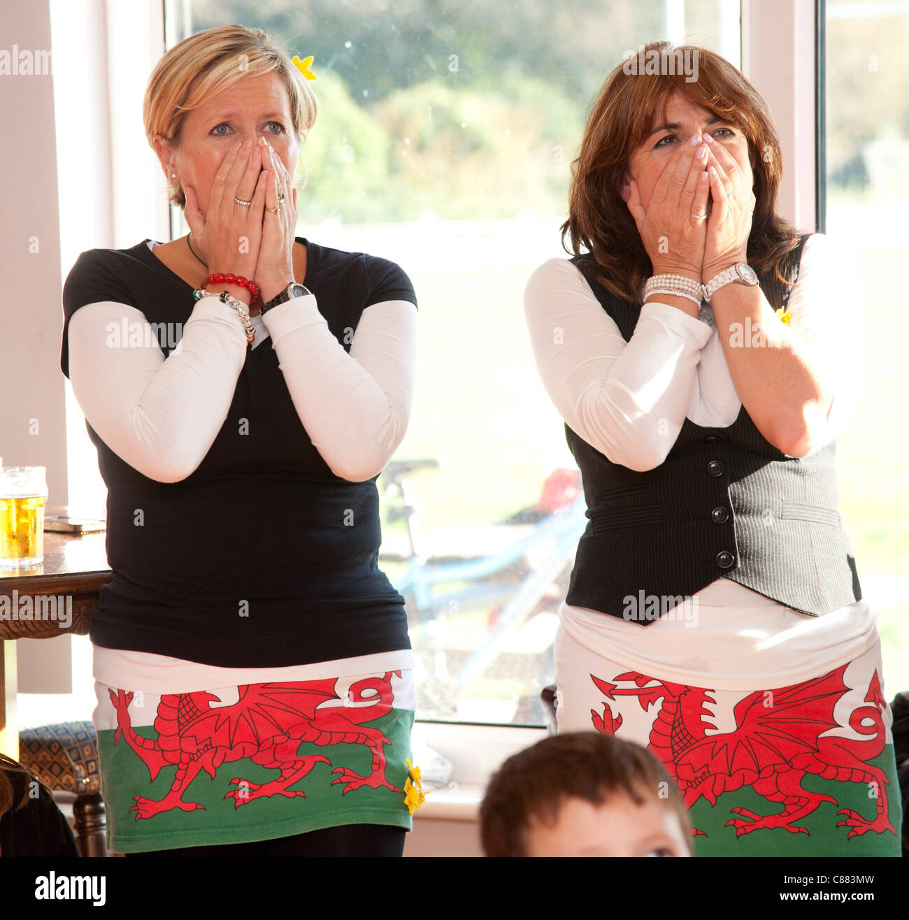 Aberystwyth Rugby club, Wales UK , 15 Oct 2011. Two female Welsh rugby fans watch the Rugby World cup semi final - Stock Image