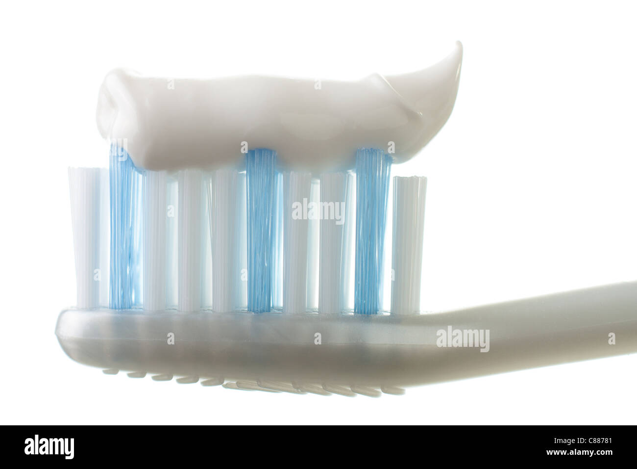 Toothbrush with Toothpaste Isolated on White - Stock Image