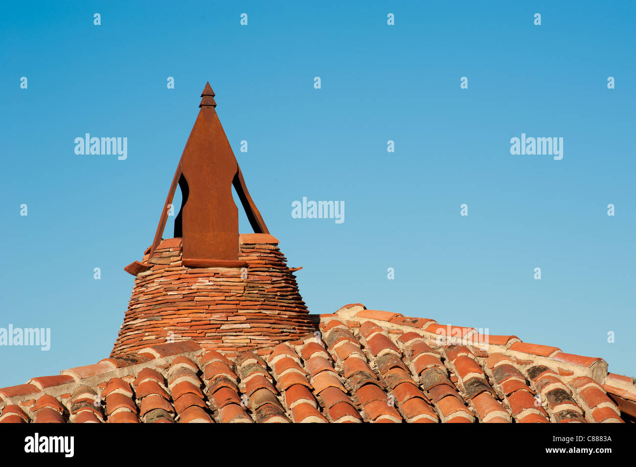 Traditional Castillian chimney on  a tiled roof Stock Photo