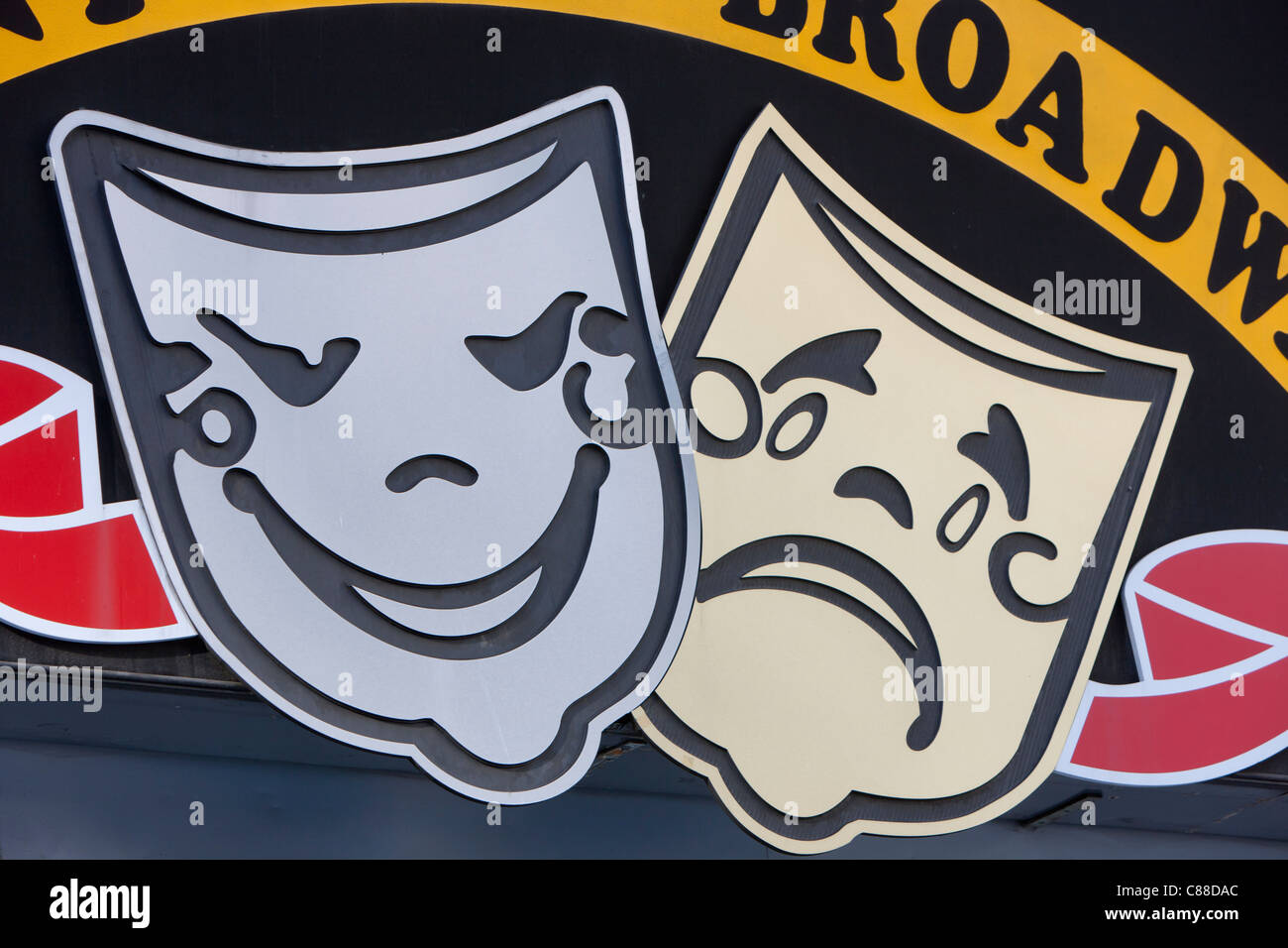 Comedy and Tragedy masks on a sign in New York City - Stock Image