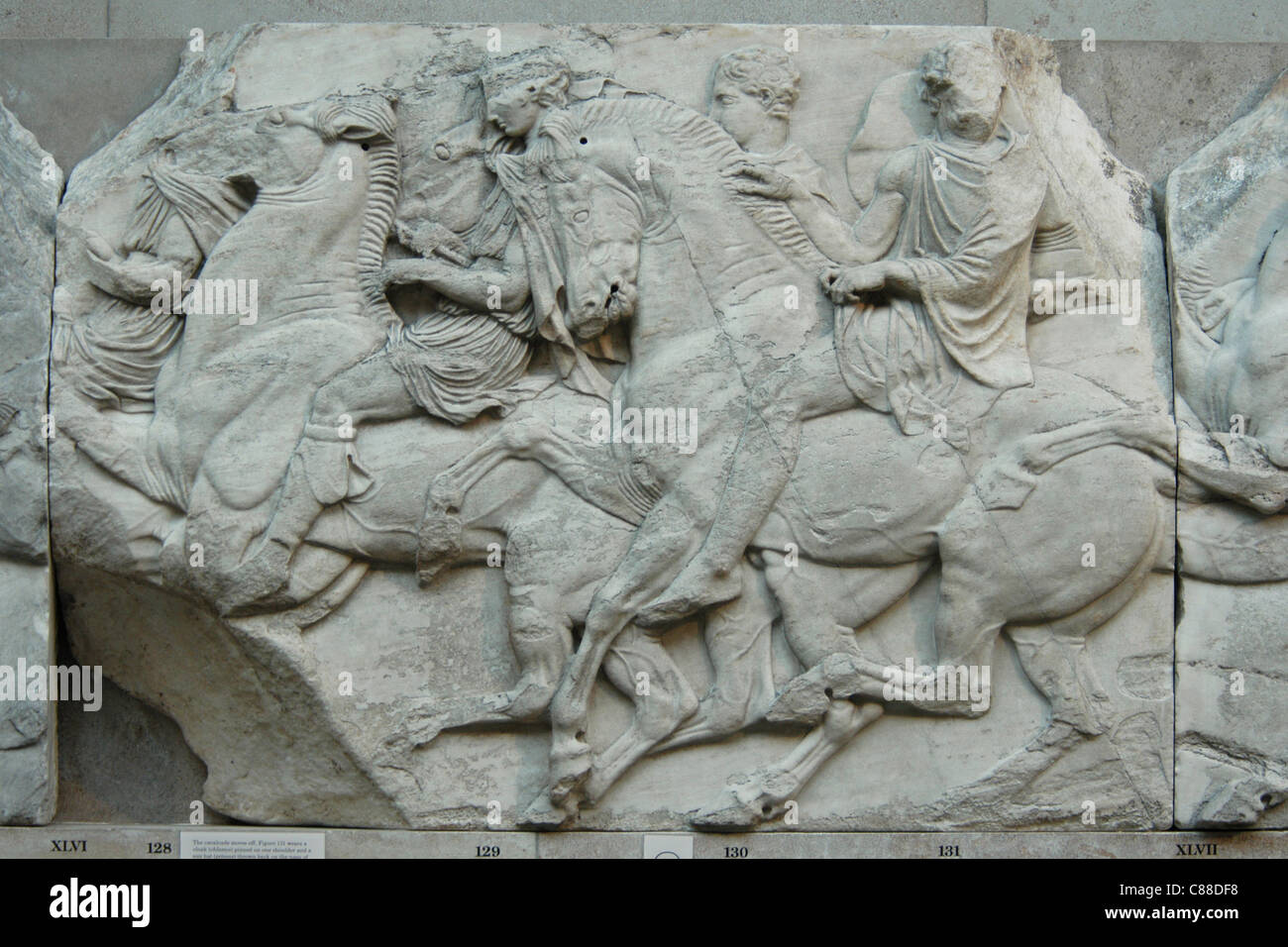 Detail of the famous Elgine's marble frieze from Parthenon seen at the British Museum in London, England, UK. - Stock Image