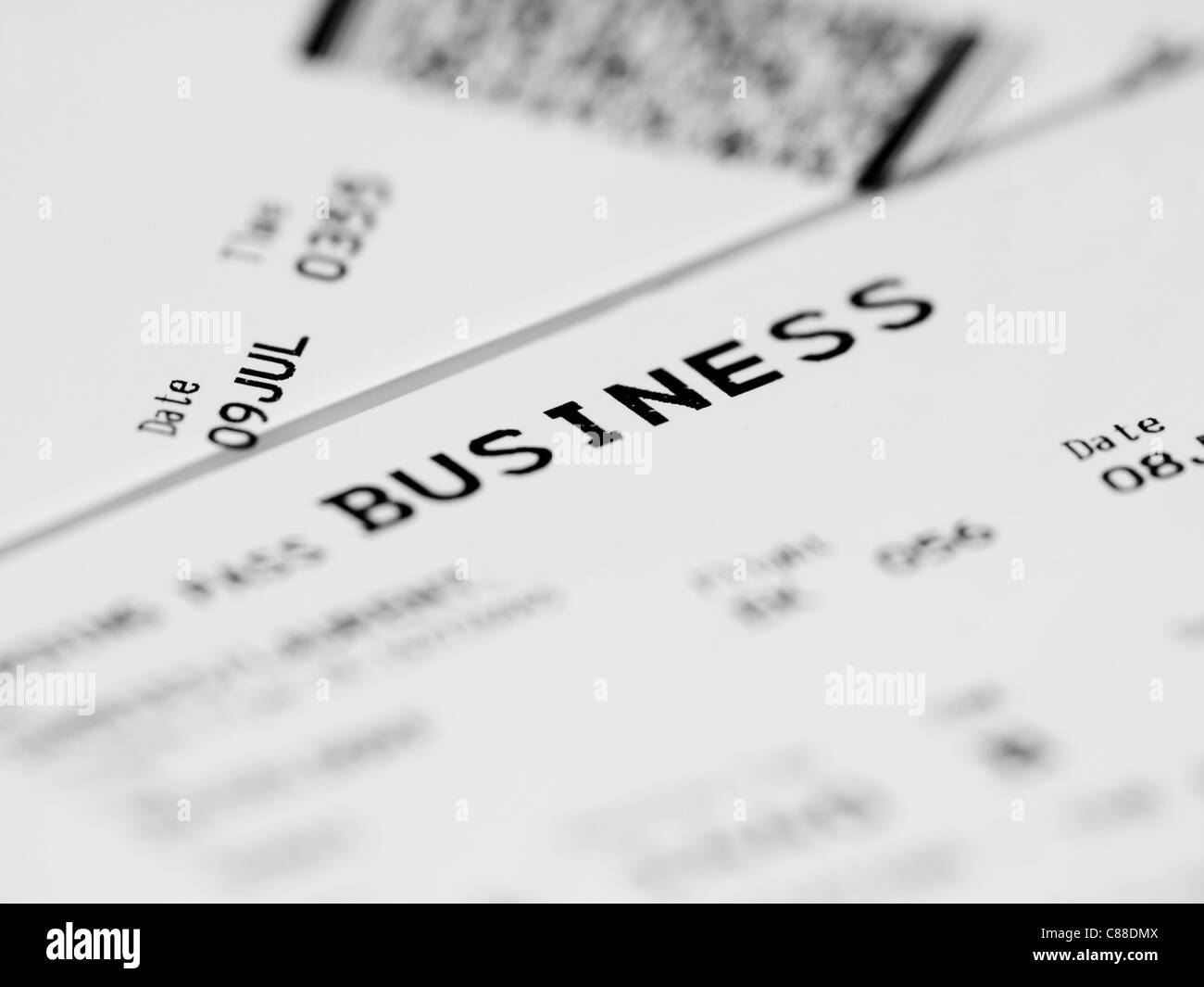 Close up of a business class ticket with shallow depth of field - Stock Image
