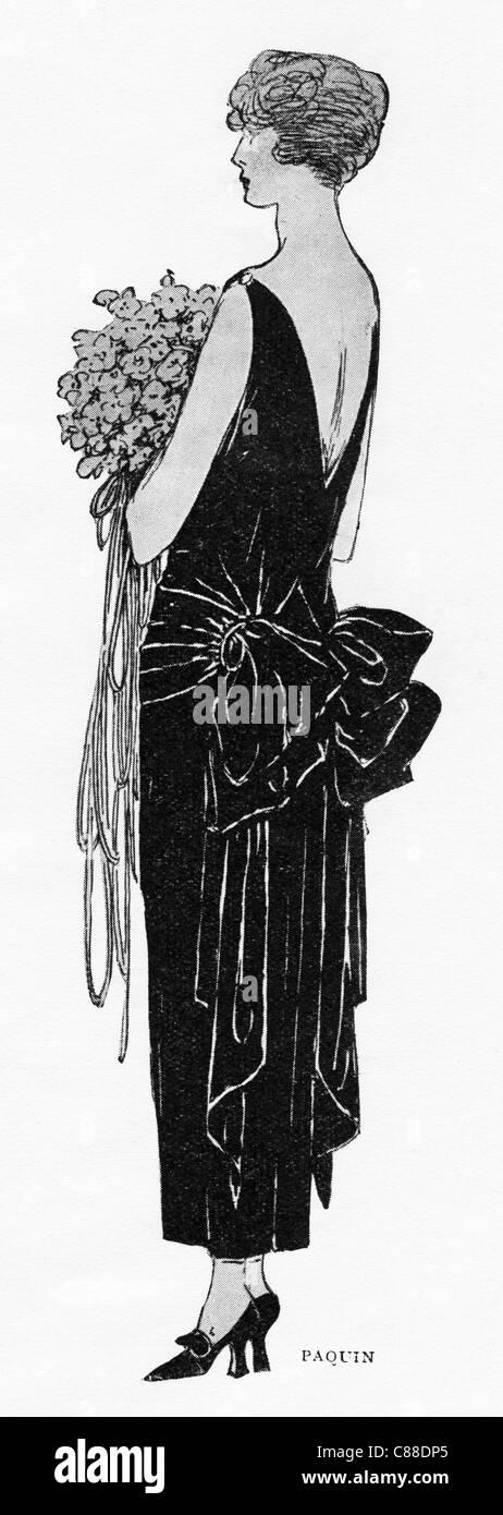 Fashion illustration circa 1922. Draped frock in black velvet by designer Paquin - Stock Image