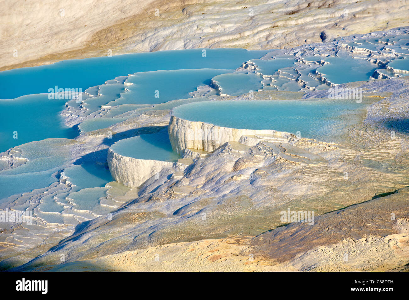 Pamukkale travetine terrace water cascades, composed of white Calcium carbonate rock formations, Pamukkale, Turkey - Stock Image