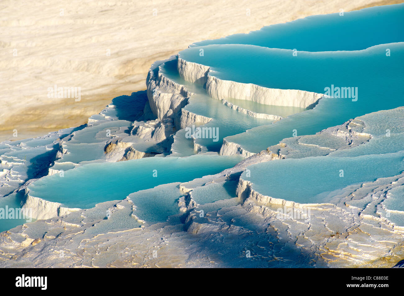 Pamukkale travetine terrace water cascades, composed of Calcium carbonate rock formations, Pamukkale, Turkey - Stock Image