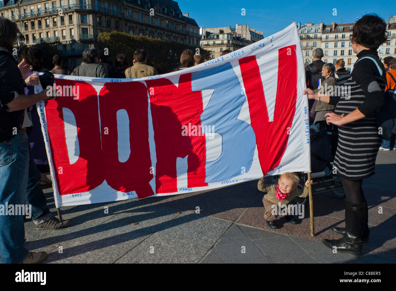 Paris, France,. French Family protesting, Holding Sign, Indignados (Indignant) movement Demonstration, International - Stock Image