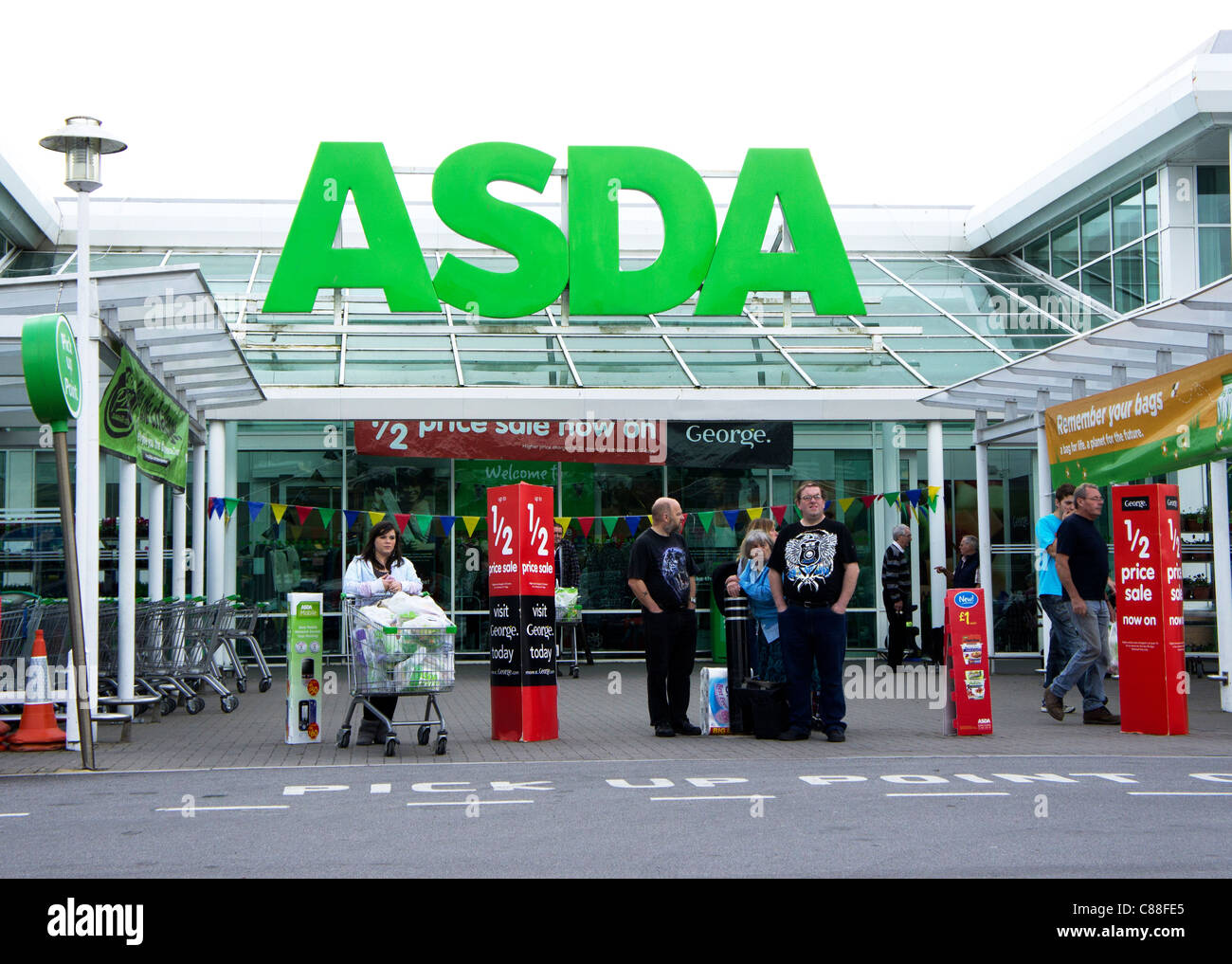 Marvelous People Waiting For Taxis Outside An Asda Store In Penryn, Cornwall, Uk    Stock