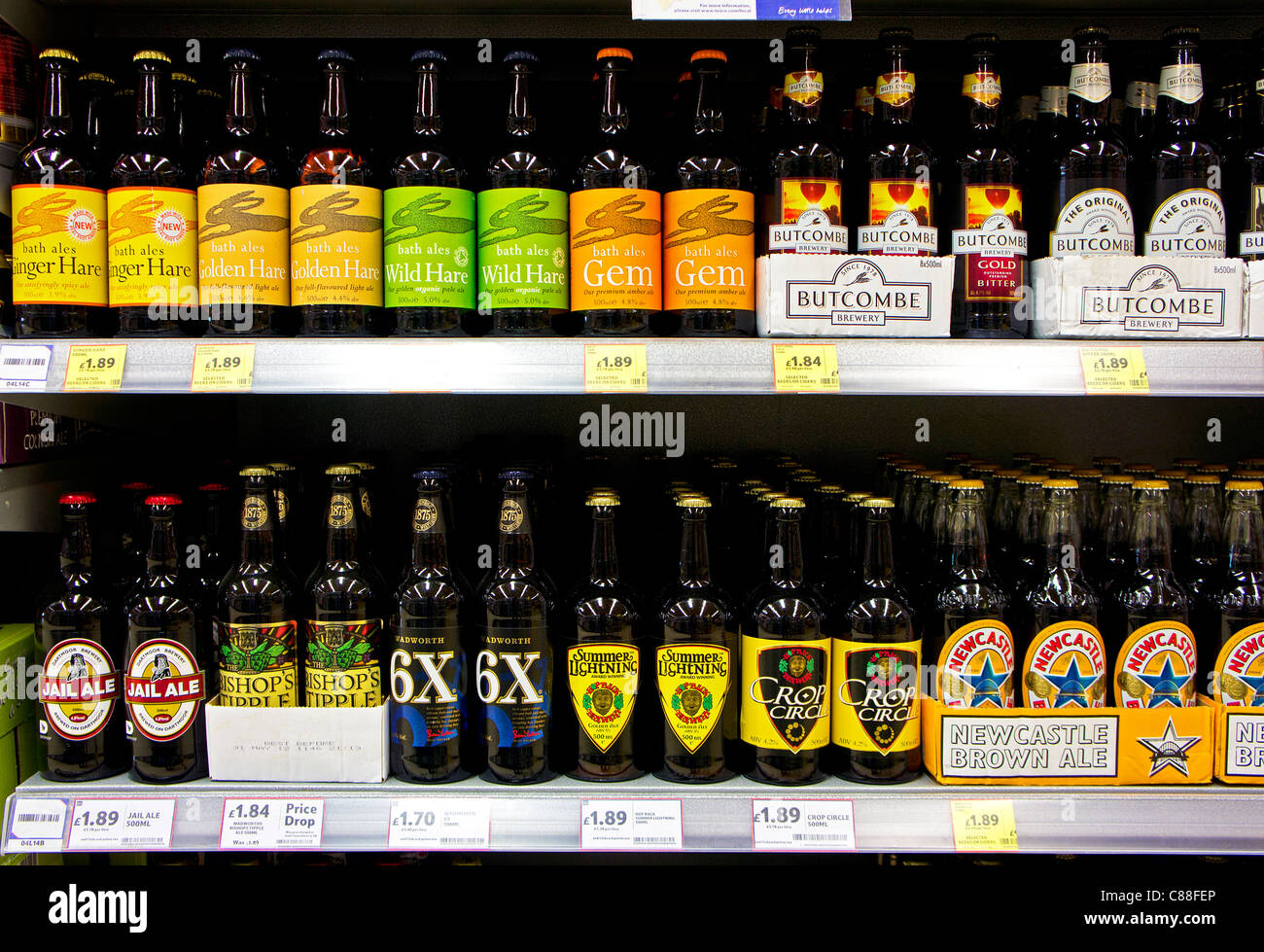 Bottles of premium beers in a UK supermarket - Stock Image