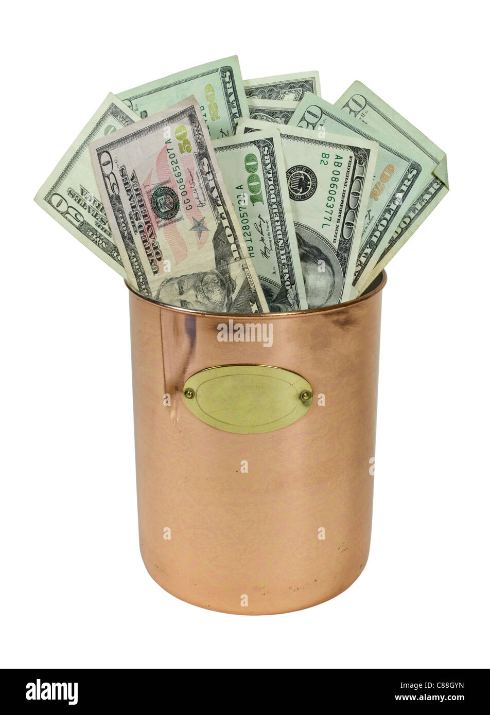Money in the form of many large bills in a large copper pot - path included - Stock Image