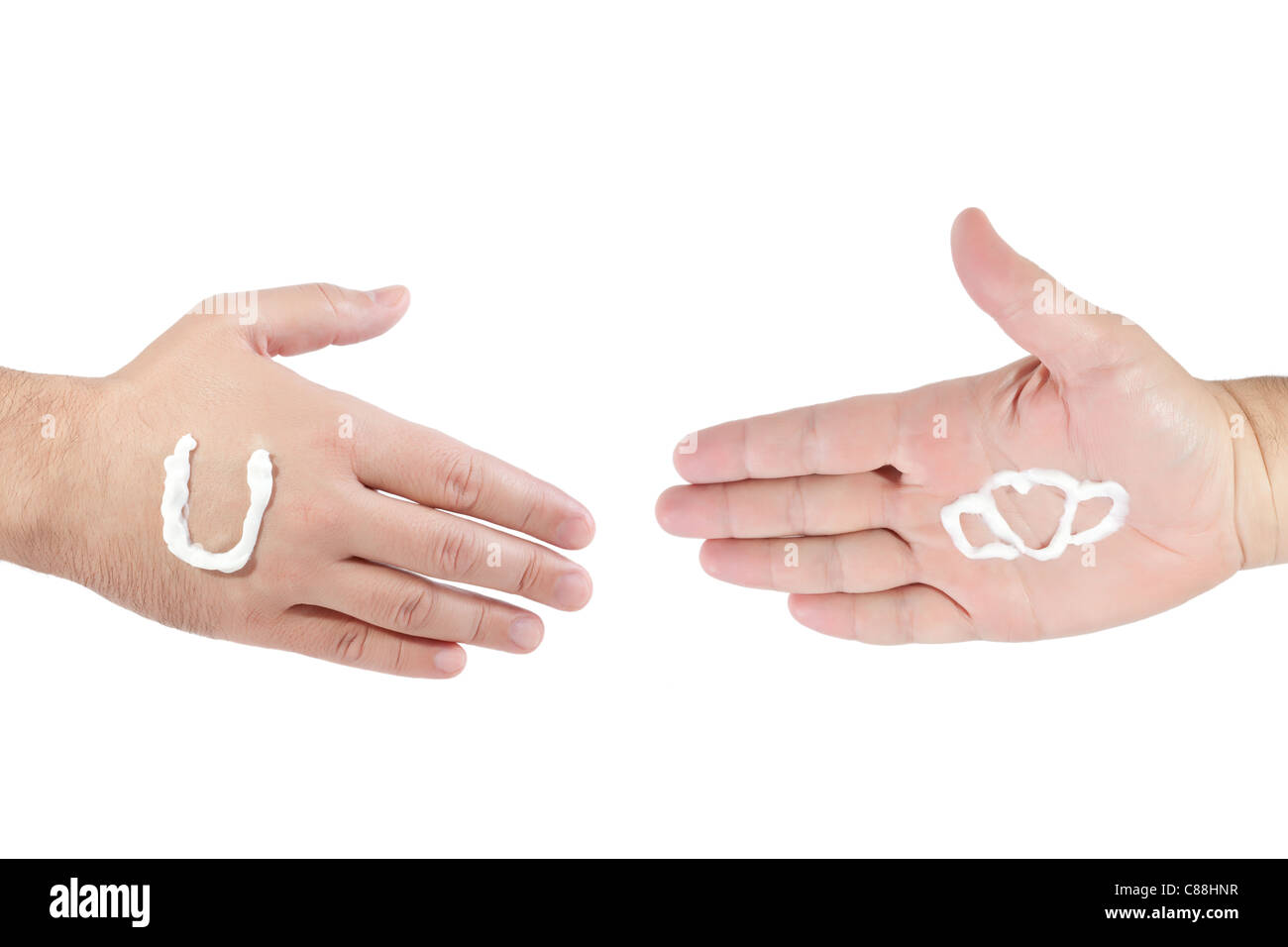 hands ready to handshake with a hand cream featuring logo of Unilever and Kalina  on white background Stock Photo
