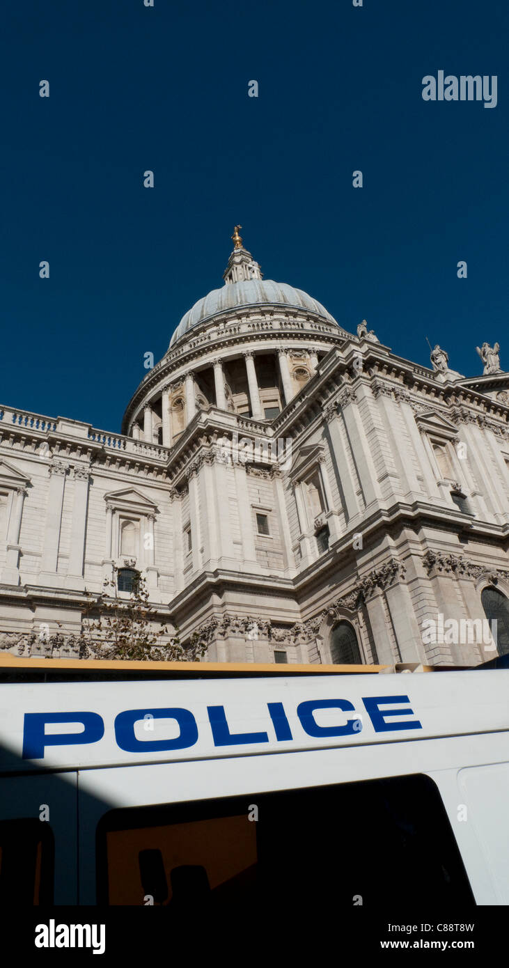 Occupy London Stock Exchange demonstration 15/10/2011. Police control access to the demonstration at St. Paul's - Stock Image