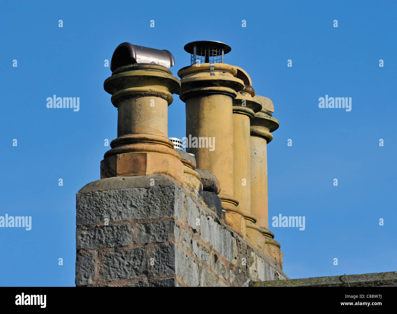 Four chimney pots. Fellside, Kendal, Cumbria, England, United Kingdom, Europe. - Stock Image