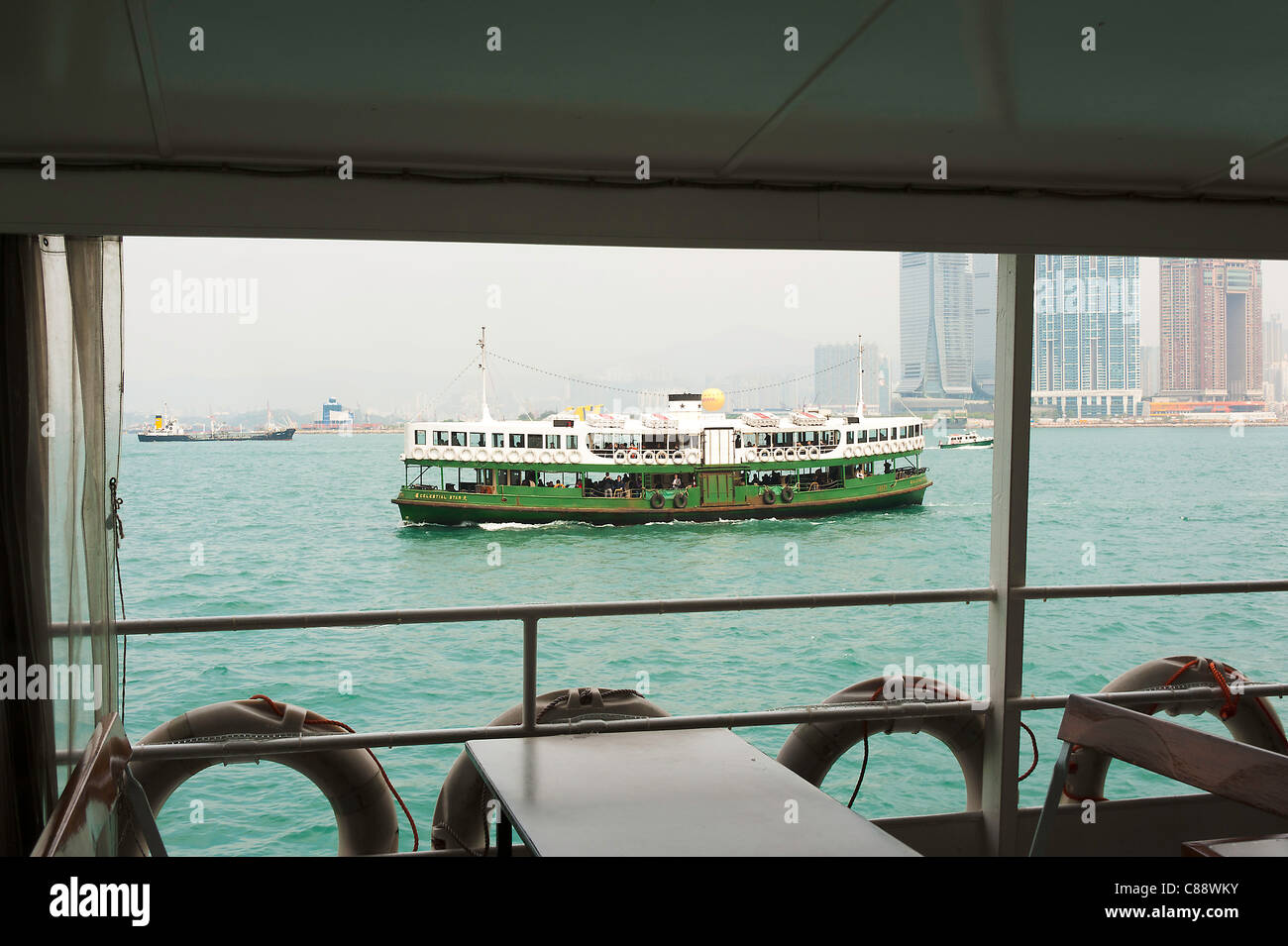 The Green and White Star Ferry Line Boat Service Celestial Star Sailing in Victoria Harbour to Kowloon Hong Kong - Stock Image