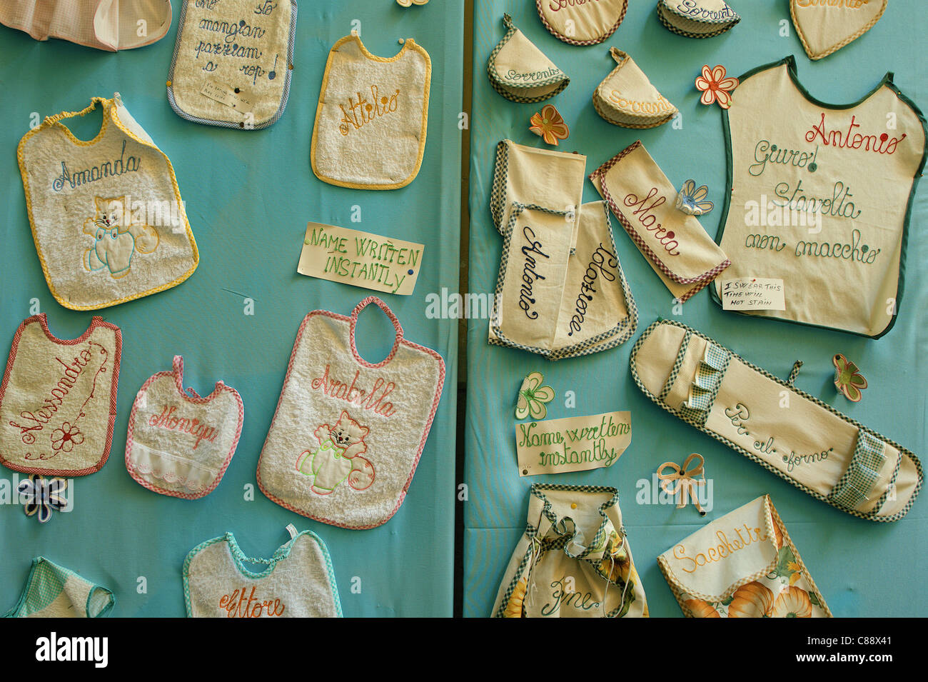 Bibs with embroided names Sorrento Italy - Stock Image