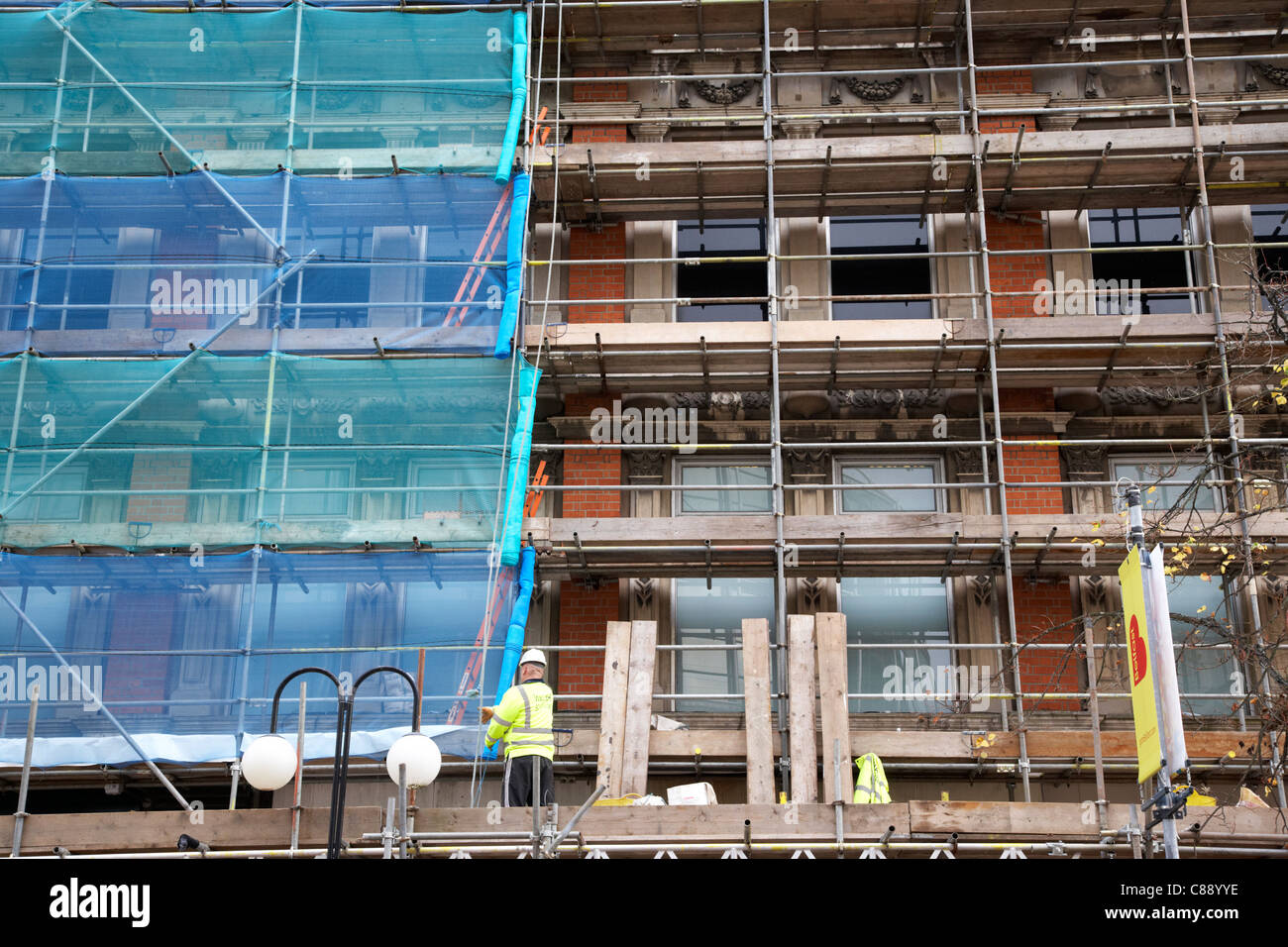 scaffolding being erected around an old building for restoration belfast city centre northern ireland uk - Stock Image
