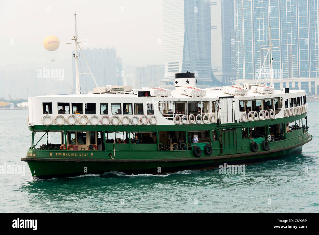 Star Ferry Line Ferryboat Twinkling Star Sailing from Central Pier Honk Kong Island Towards Kowloon China Asia - Stock Image